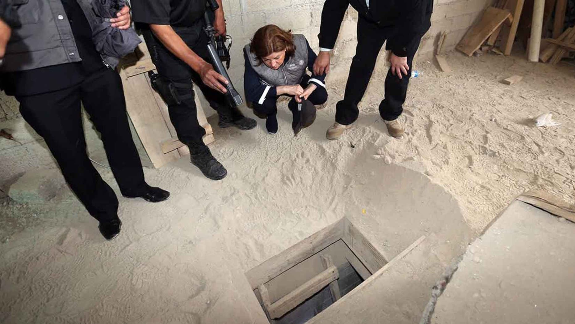 """Authorities inspect the exit of the tunnel used by Joaquin """"El Chapo"""" Guzman on Sunday, July 12, 2015."""