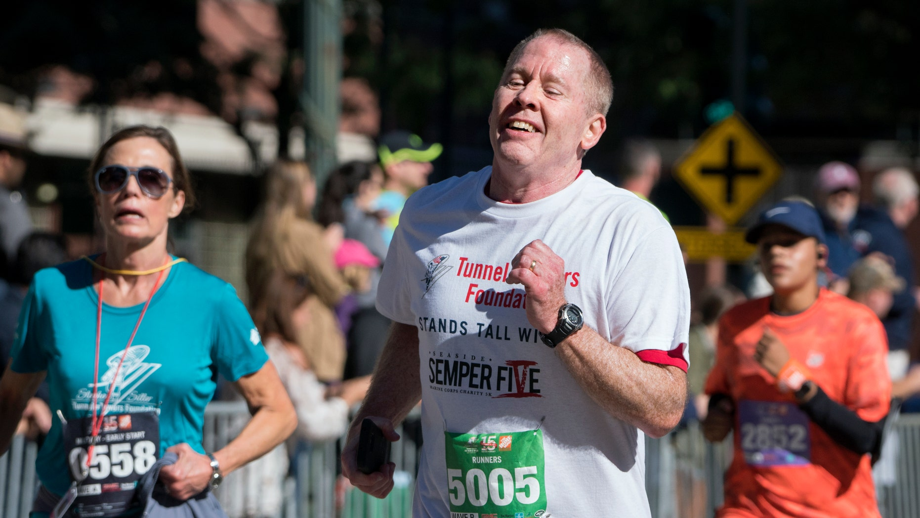 """Robert Schenk nears the finish line of the """"Stephen Siller Tunnel to Towers"""" race. Schenk had been set to run in a race in Seaside, N.J., but it was canceled when a pipe bomb went off."""