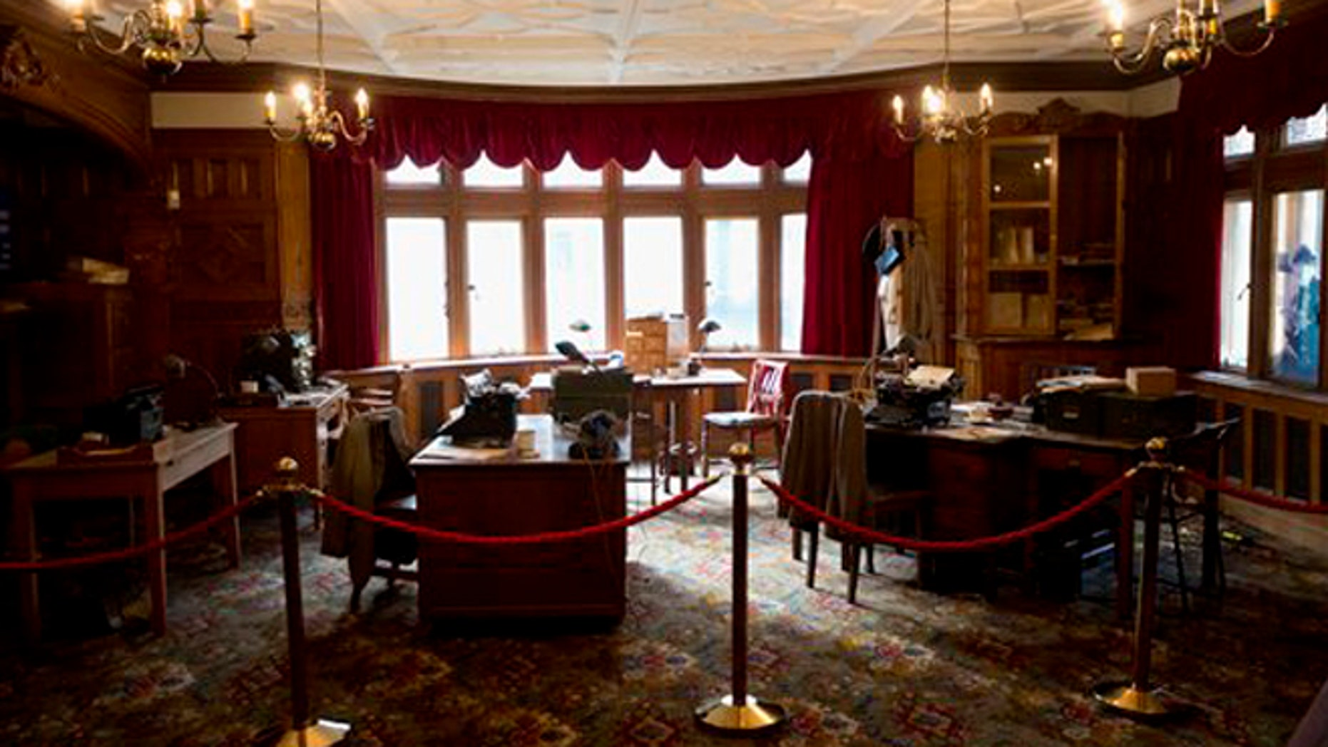 In photo dated Thursday, Jan. 15, 2015, a library exhibit at Bletchley Park, as it would have been used by infamous codebreaker Alan Turing during World War II, in Bletchley, England. (AP Photo/Matt Dunham)