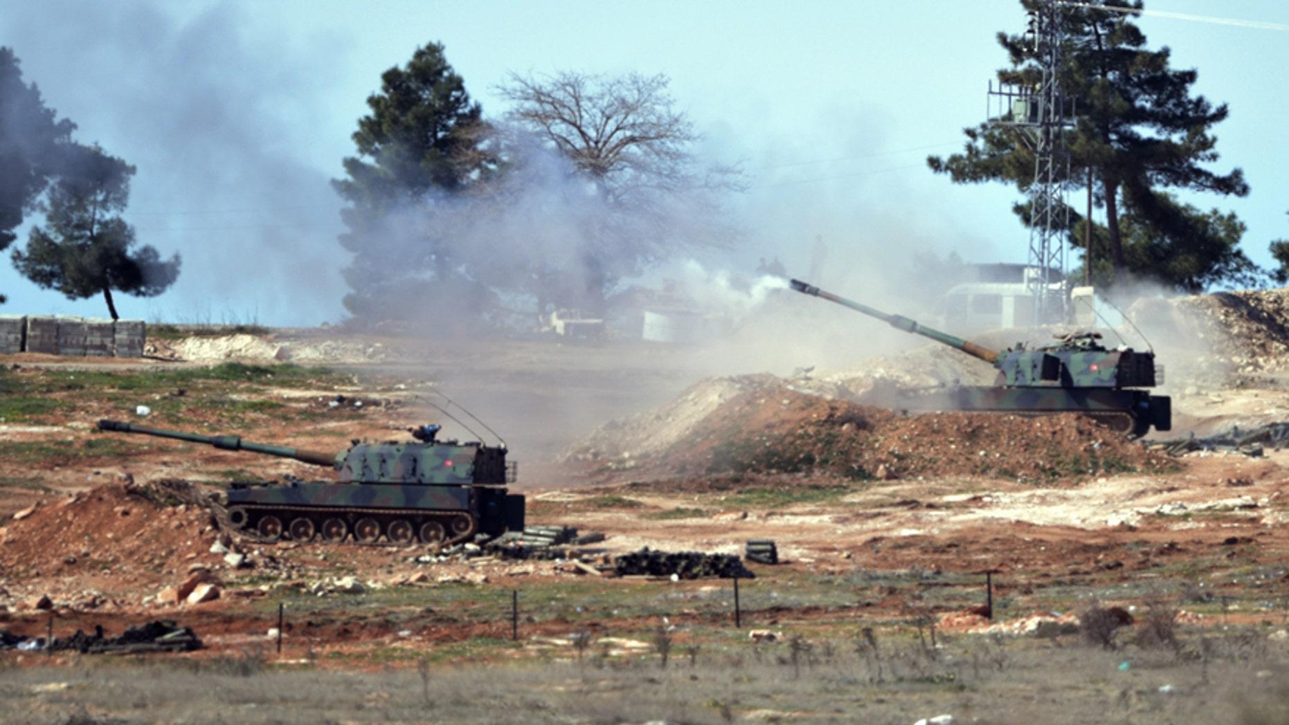 Feb. 16, 2016: Turkish artillery fire from the border near Kilis town toward northern Syria, in Kilis, Turkey.