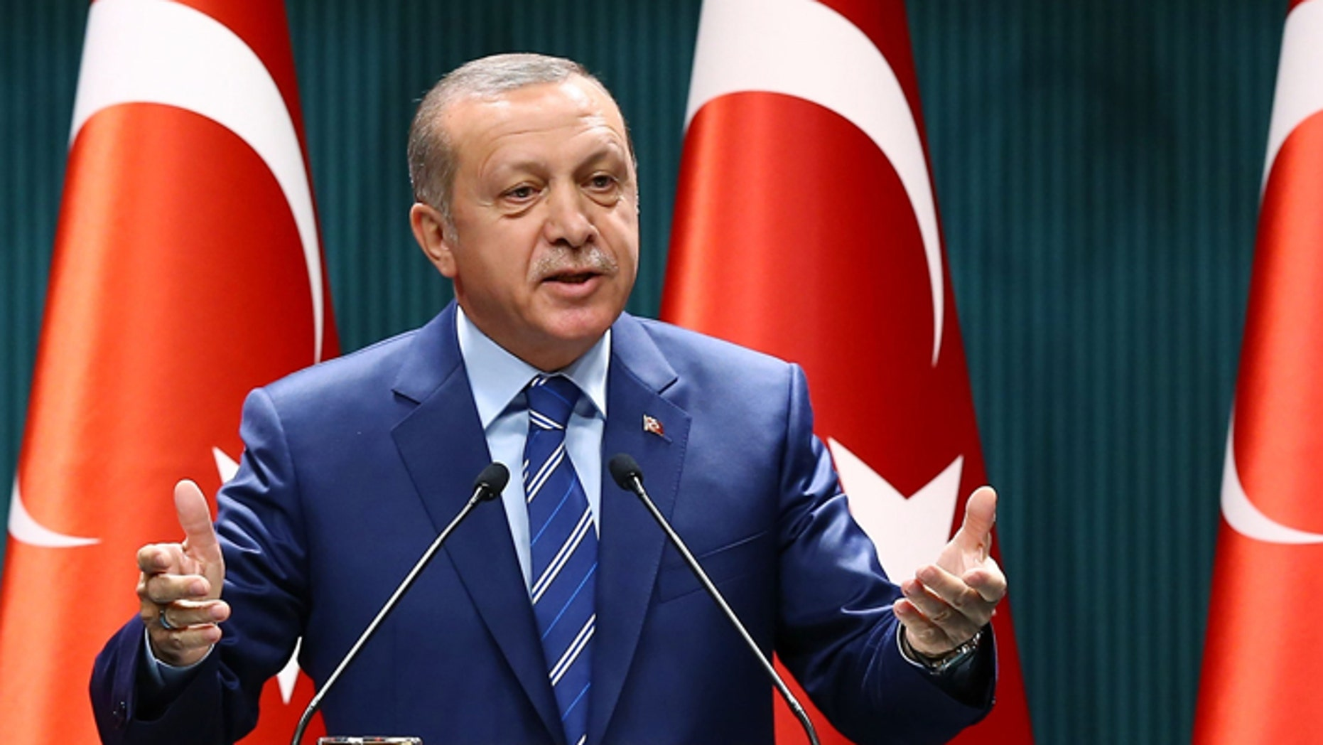 Turkish President Recep Tayyip Erdogan delivers a speech at the Presidential Palace in Ankara, Thursday, Aug. 18, 2016.