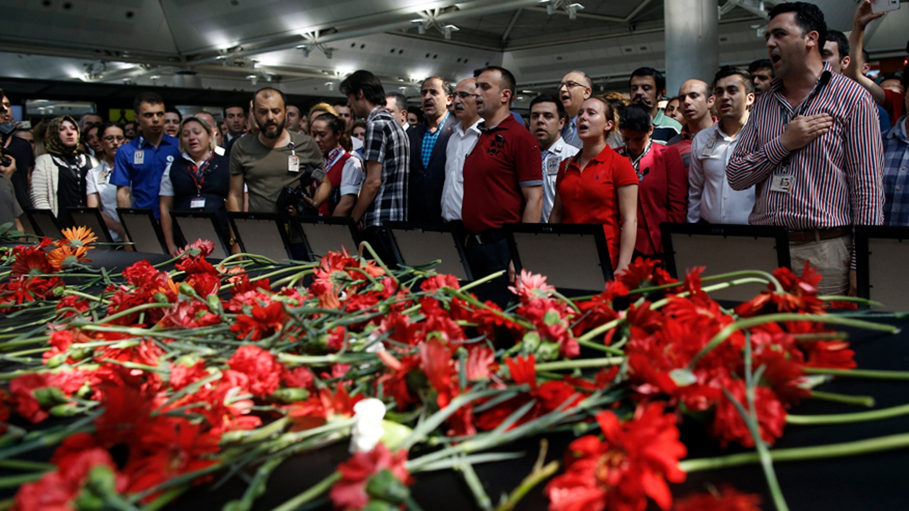 June 30, 2016: Family members, colleagues and friends of the victims of Tuesday blasts gather for a memorial ceremony at the Ataturk Airport in Istanbul.