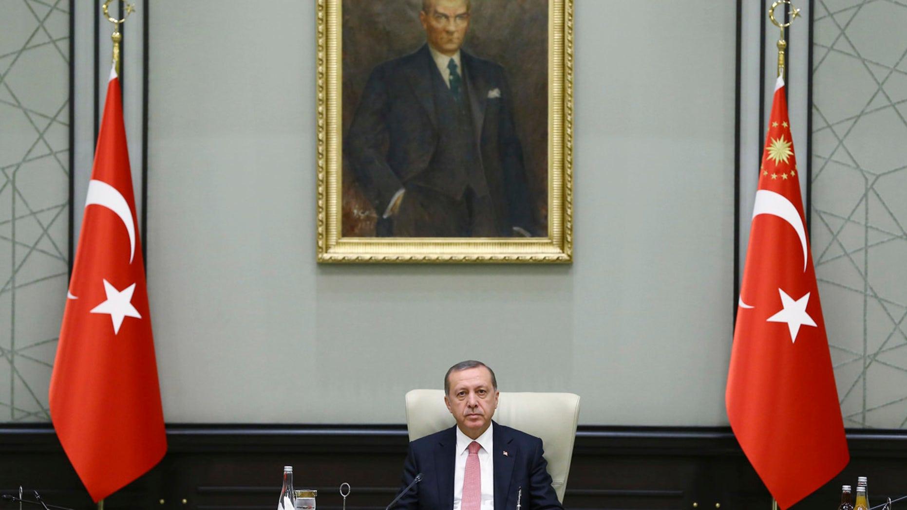 July 25, 2016: Under a portrait of Turkish Republic founder Mustafa Kemal Ataturk,Turkey's President Recep Tayyip Erdogan chairs a cabinet meeting