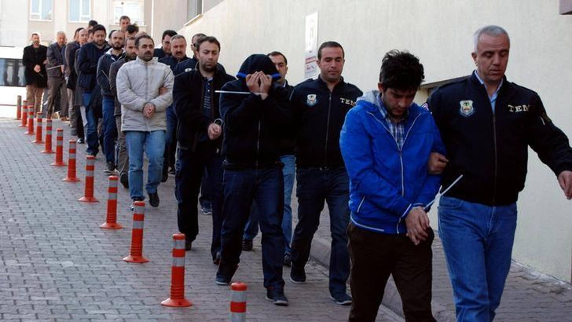 Suspected supporters of the U.S.-based cleric Fethullah Gulen escorted by plainclothes police officers at police headquarters in Kayseri, Turkey, on Tuesday.