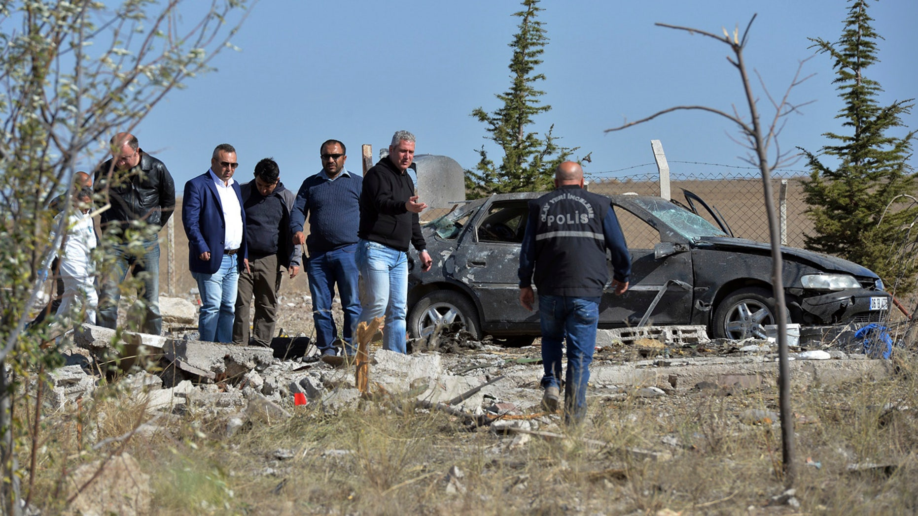Oct. 8, 2016: Police forensic officers work at the scene after suicide bombers blew themselves up in Haymana in the outskirts of the capital Ankara, Turkey.