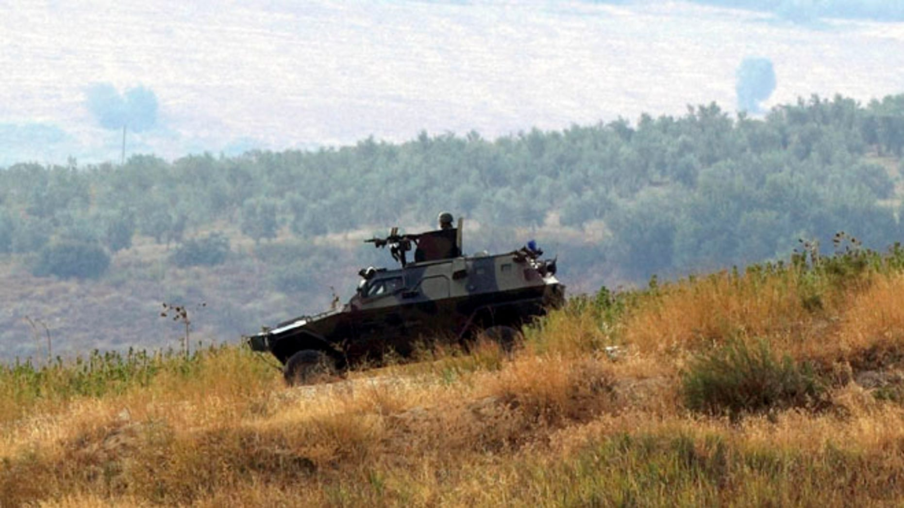 Oct. 9, 2012: Turkish soldiers in a military vehicle patrol on the Turkish-Syrian border near the village of Hacipasa in Hatay province, southern Turkey.