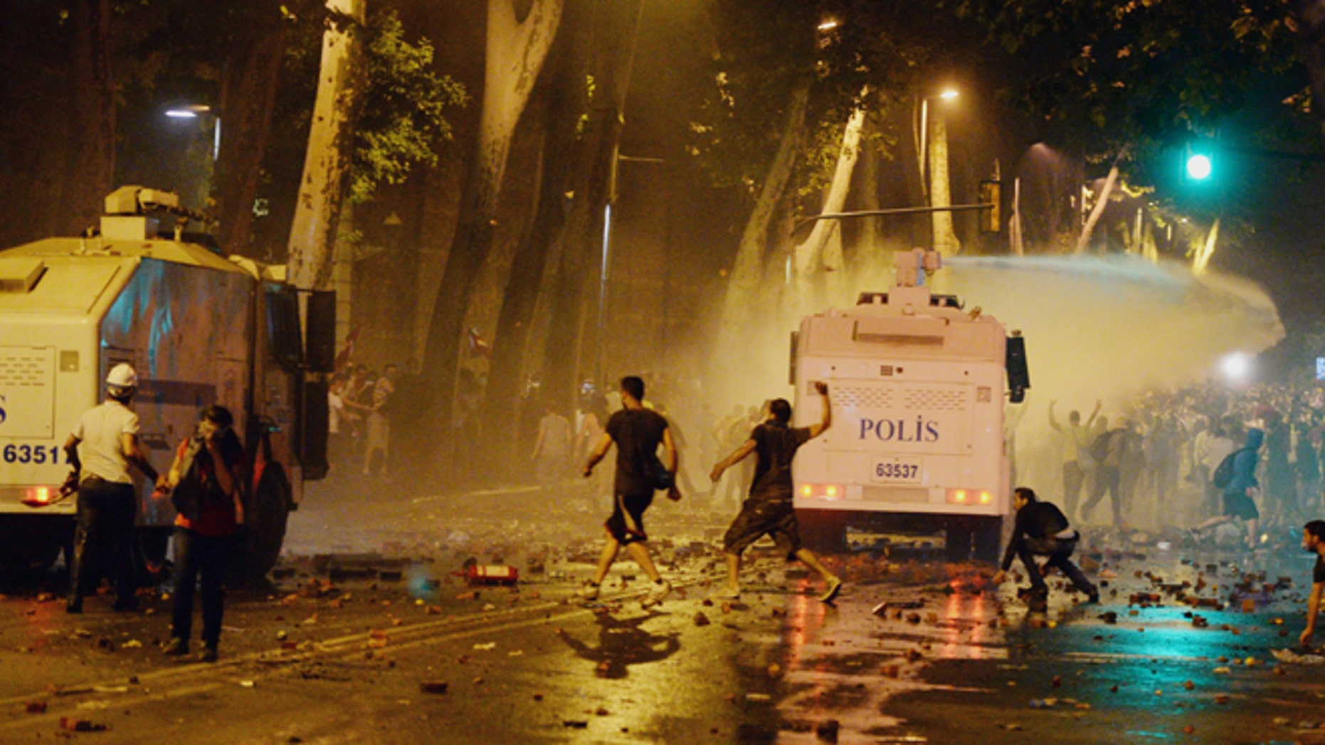 June 1, 2013 - Turkish protesters clash with riot police near the former Ottoman palace, Dolmabahce, where Turkey's Prime Minister Recep Tayyip Erdogan maintains an office in Istanbul, Turkey.