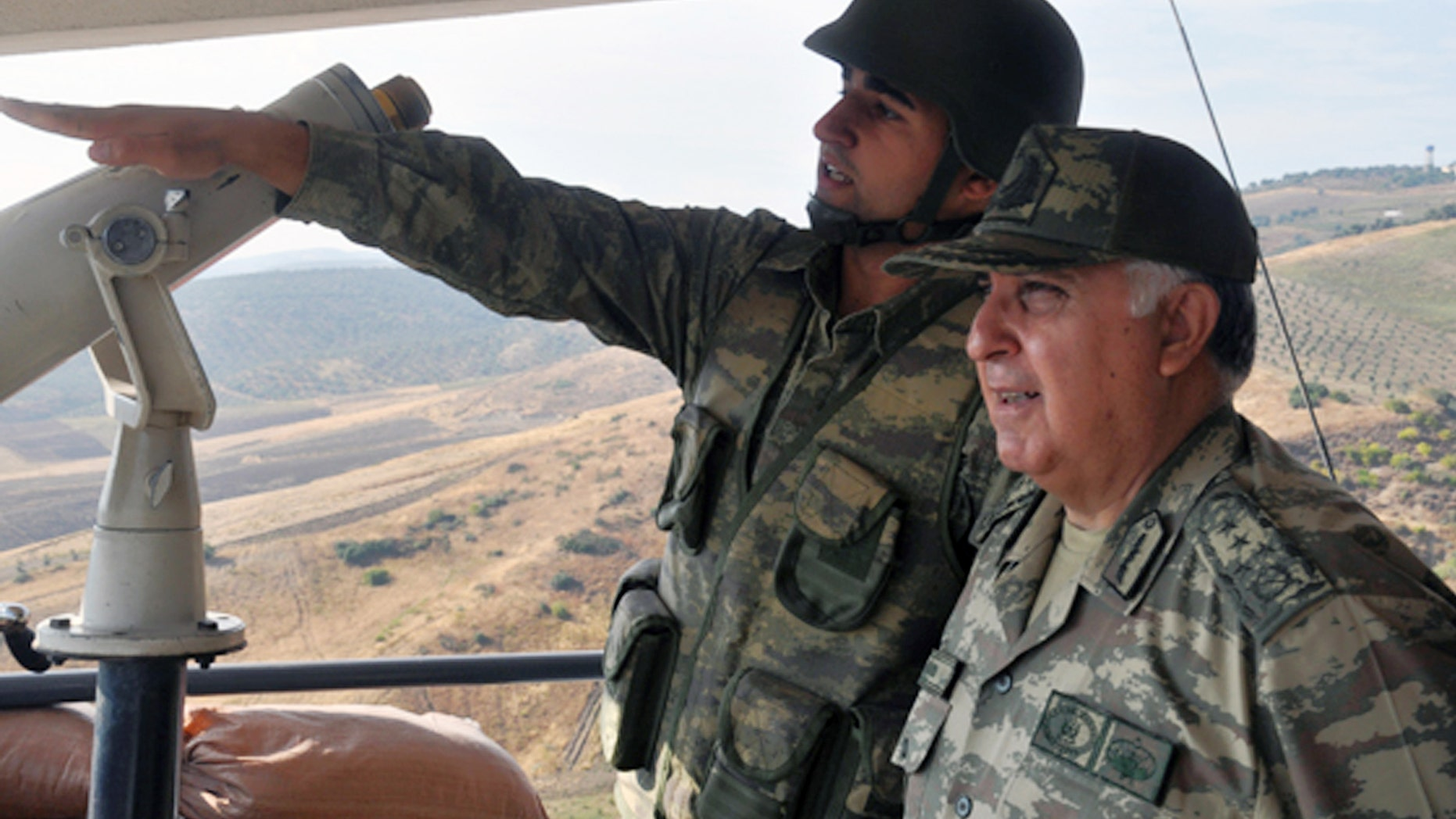 Oct. 9, 2012: Turkish Chief of Staff Gen. Necdet Ozel, right, listens to a commander during his tour of the military along the border with Syria in Hatay, Turkey.