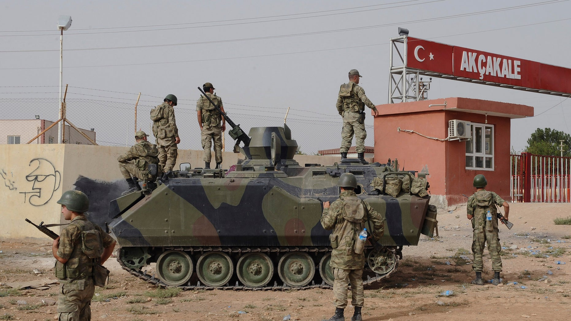 Oct. 7, 2012.: Turkish military station at the border gate with Syria, across from Syrian rebel-controlled Tel Abyad town, in Akcakale, Turkey.