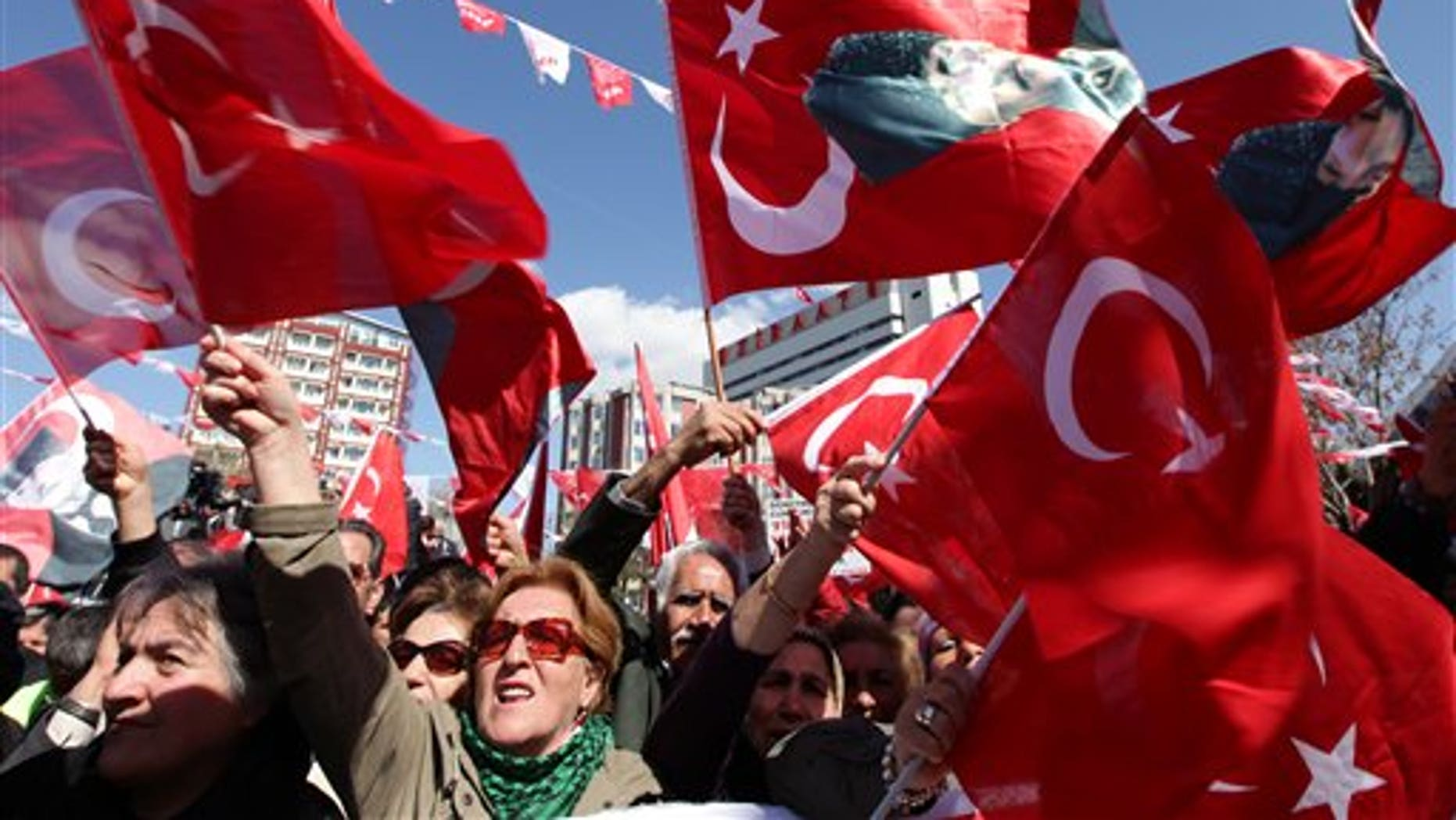 March 27, 2012: Supporters cheer Kemal Kilicdaroglu, leader of the main opposition Republican People's Party, unseen, during a rally in Ankara, Turkey.