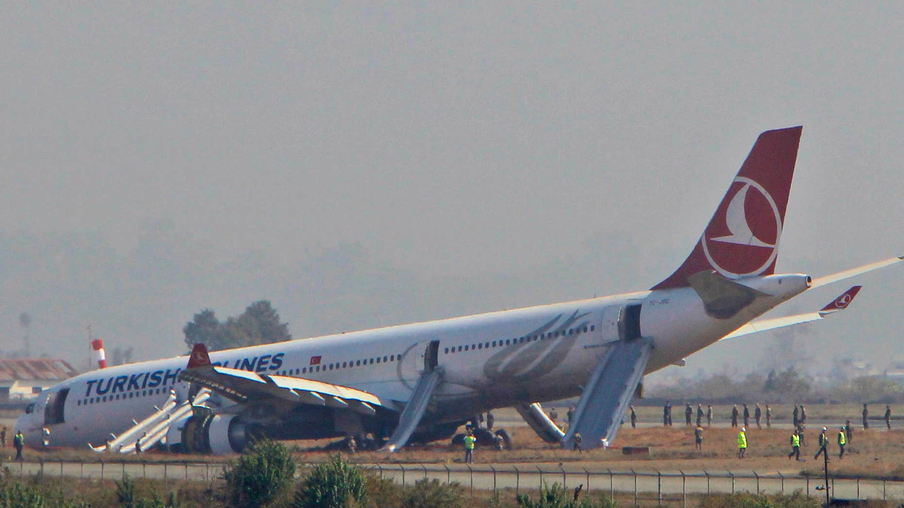 March 4, 2015: A Turkish Airlines jet is seen after it skidded off a slippery runway while landing in dense fog at Tribhuwan International Airport in Kathmandu, Nepal.