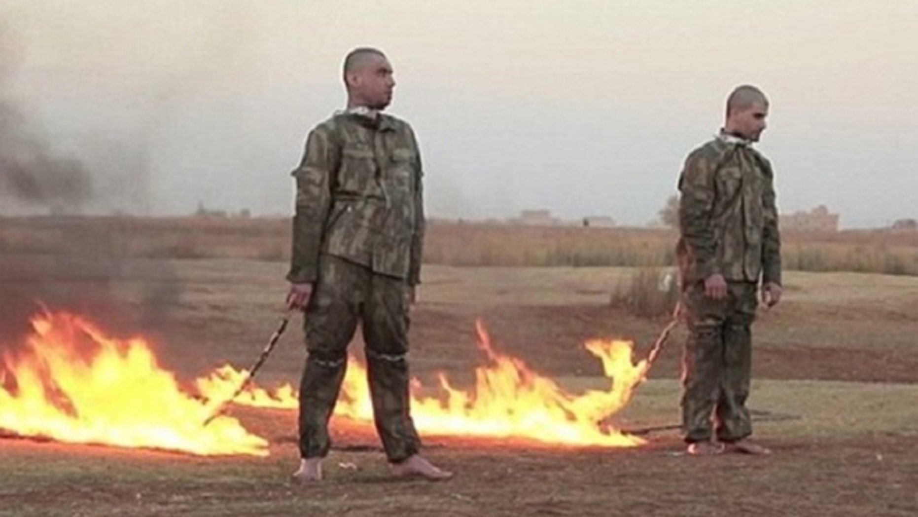 Grim screenshot from ISIS video shows two Turkish soldiers moments before they were burned alive.