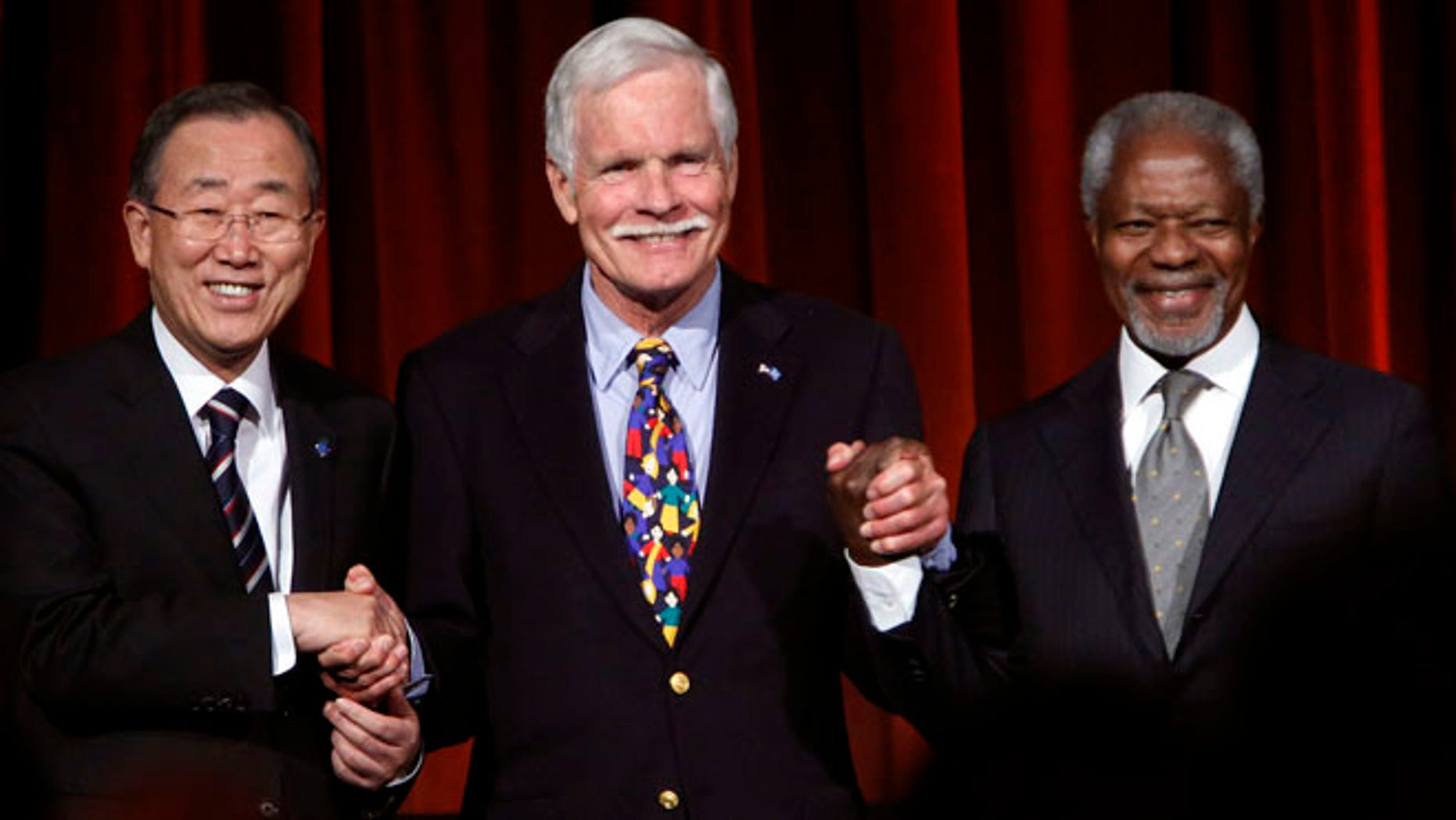 Oct. 16, 2012: U.N. Secretary-General Ban Ki-moon (L), U.N. Foundation founder and chairman Ted Turner (C) and former U.N. Secretary-General Kofi Annan pose as they celebrate the 15th anniversary of Turner's historic $1 billion gift to the U.N. at the Global Leadership Awards dinner hosted by the U.N. Foundation and United Nations Association-USA in New York. (Reuters)