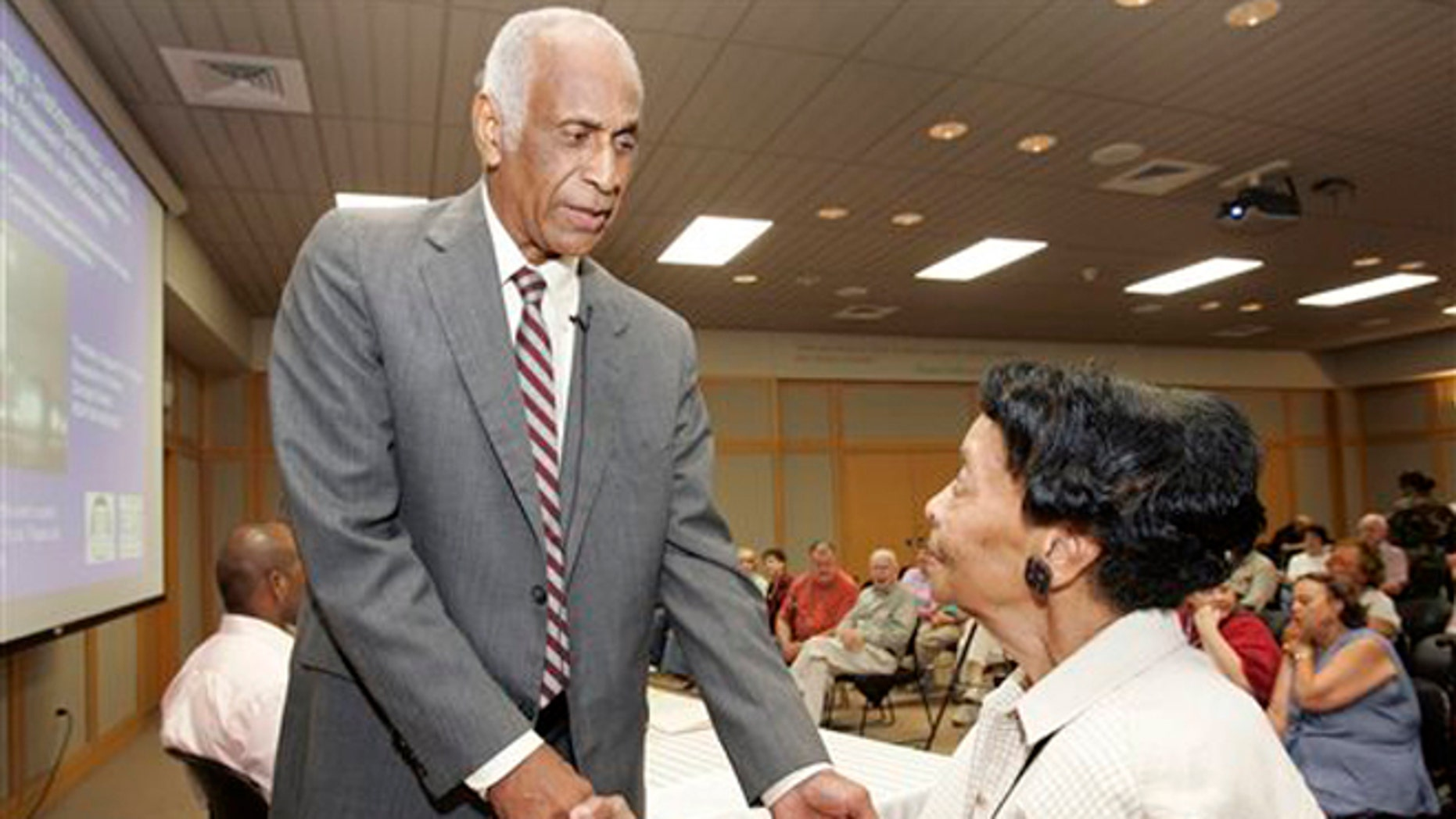 Aug. 1, 2007: In this photo, Milton Crenchaw, who was a member of the first all-black unit in the Army Air Corps during World War II known as the Tuskegee Airmen, left, speaks with Thessia Dunn before participating in a lecture series at the Butler Center for Arkansas Studies in Little Rock, Ark.