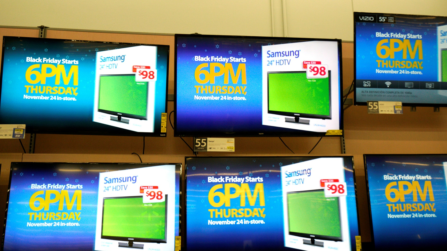 File photo - Advertisements of the upcoming Black Friday sales are seen on TV screens at a Walmart store in Westminster, Colorado, U.S. Nov. 23, 2016. (REUTERS/Rick Wilking)