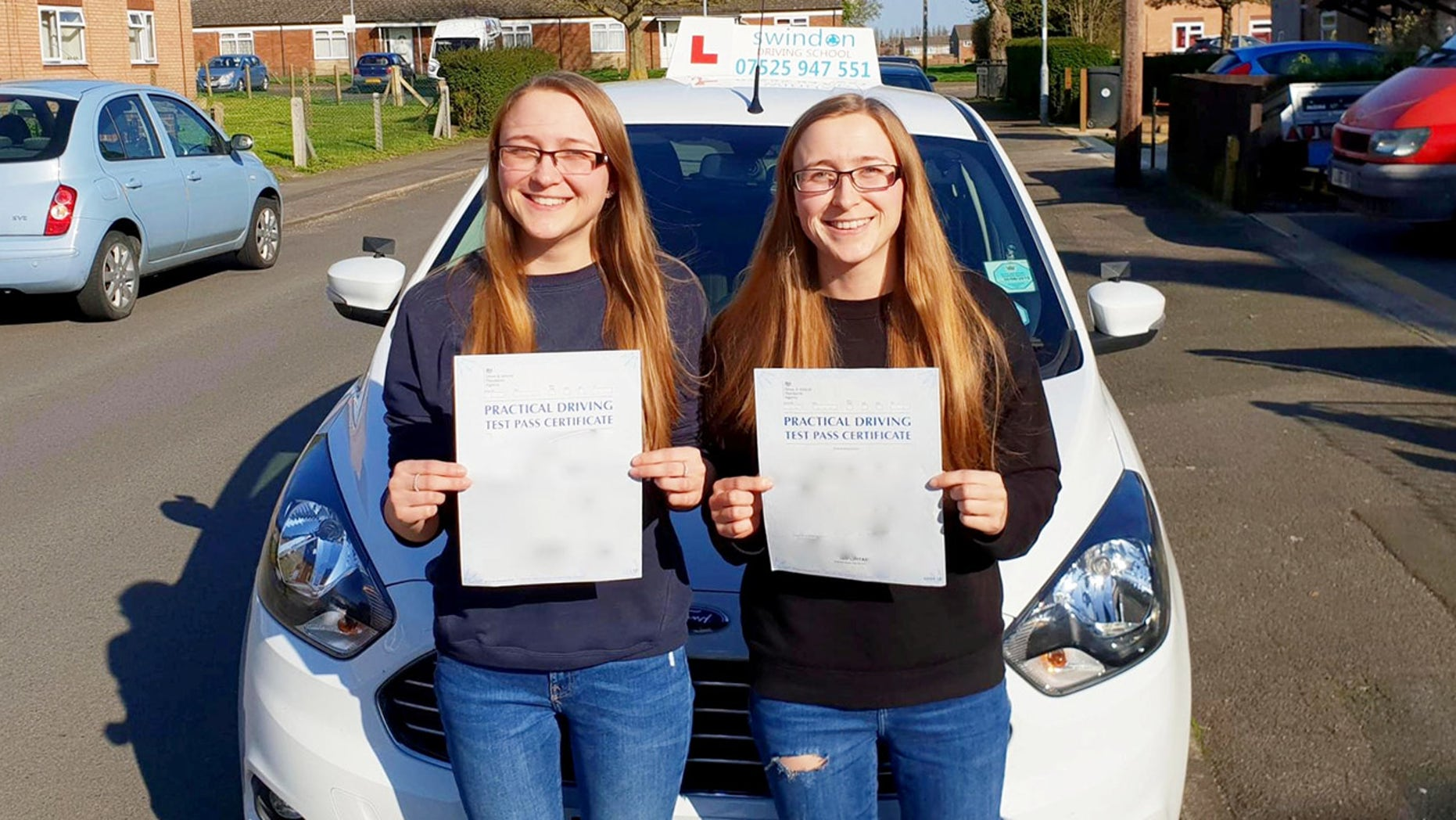 """Twins Becky and Nicky Dodson passed their driving test on the same day.  Twin sisters are celebrating after both passing their driving tests - on the same day.  See SWNS story SWTWINS.  The pair even stuck to the traditional order - with first-born Becky Dodson passing hours before her sister.  The 24-year-olds faced adversity when Man United fan Nicky dislocated her shoulder six days before the test - celebrating a winning goal in the Manchester derby.  And even the date - Friday, April 13 - was a bad omen they were unfazed by.  Nicky and Becky of Swindon, Wilts, both bought 2016 plate Peugeot 208s after passing their test and drove to work for the first time today.  Dad Melvyn, 55, said the girls """"share each other's pain and joy"""" and """"leapt into each other's arms"""" after learning they'd both passed.  The twins, who were born eight weeks premature, work for a firm which supplies wiring for other businesses. They even started on the same day."""