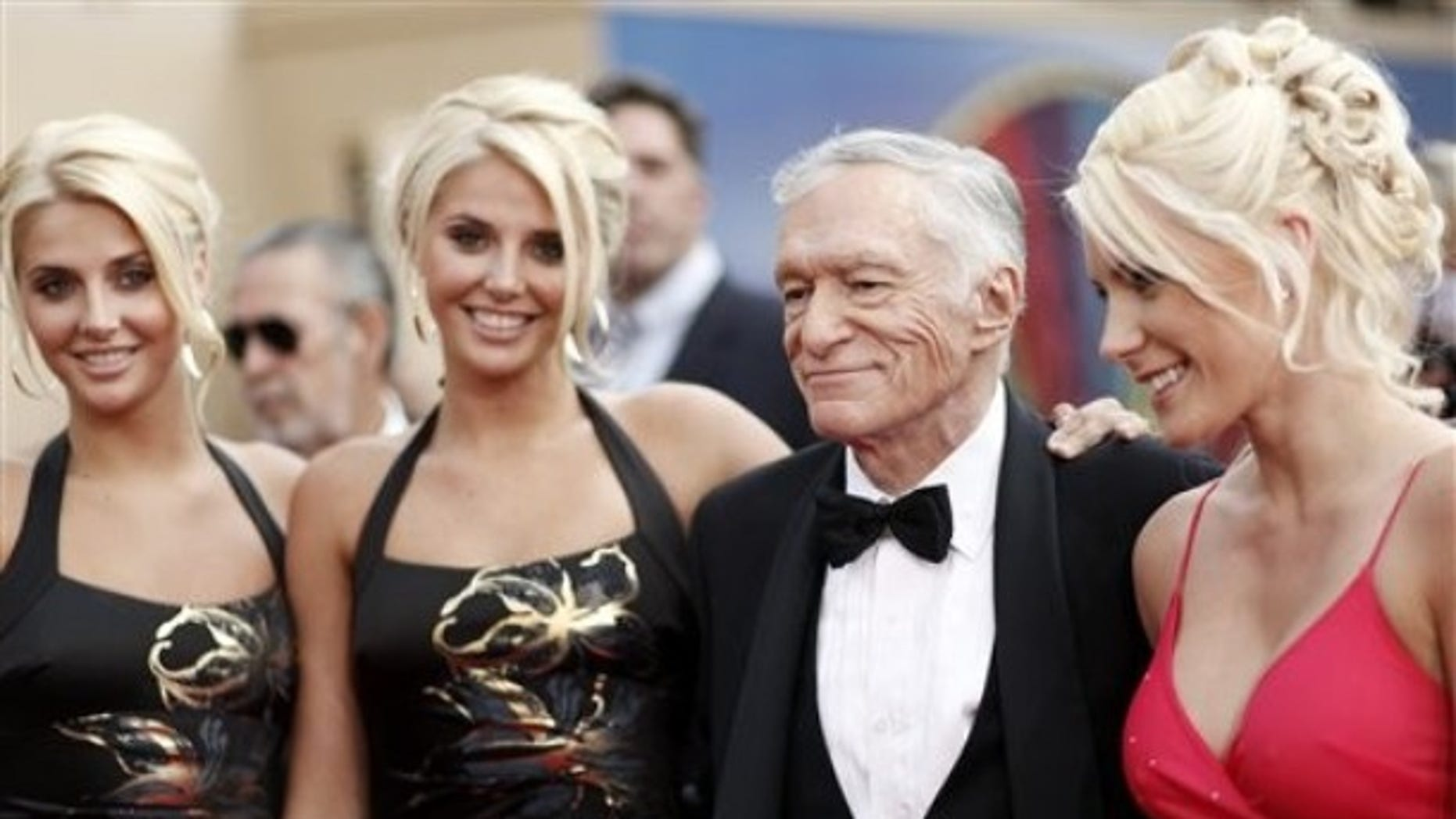 June 11, 2009: Identical twins Karissa and Kristina Shannon, Hugh Hefner, second from right, and Crystal Harris, right, arrive at the taping of the American Film Institute Life Achievement Awards honoring actor Michael Douglas in Culver City, Calif.