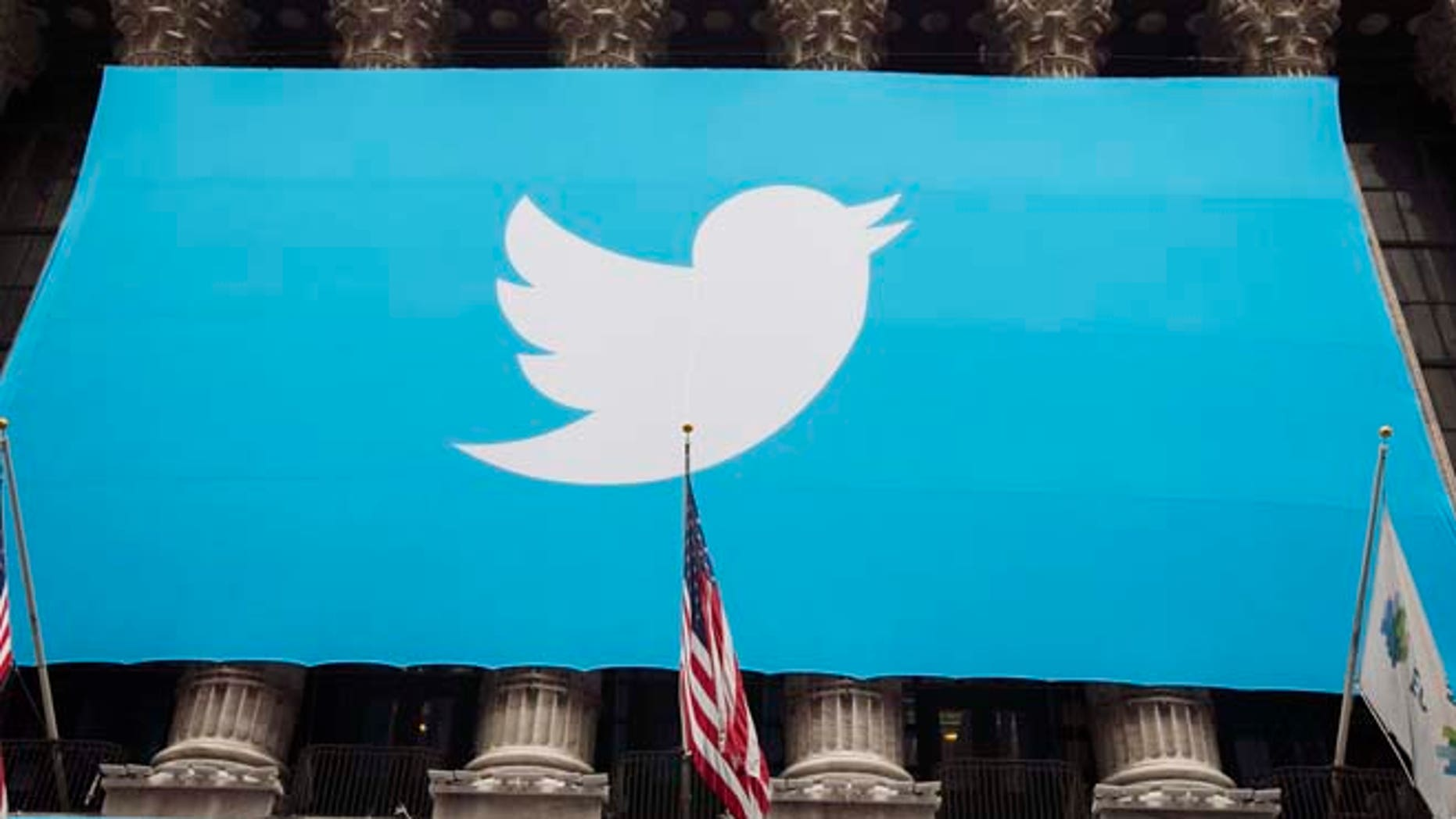 A sign displays the Twitter logo on the front of the New York Stock Exchange in New York, Nov. 7, 2013.