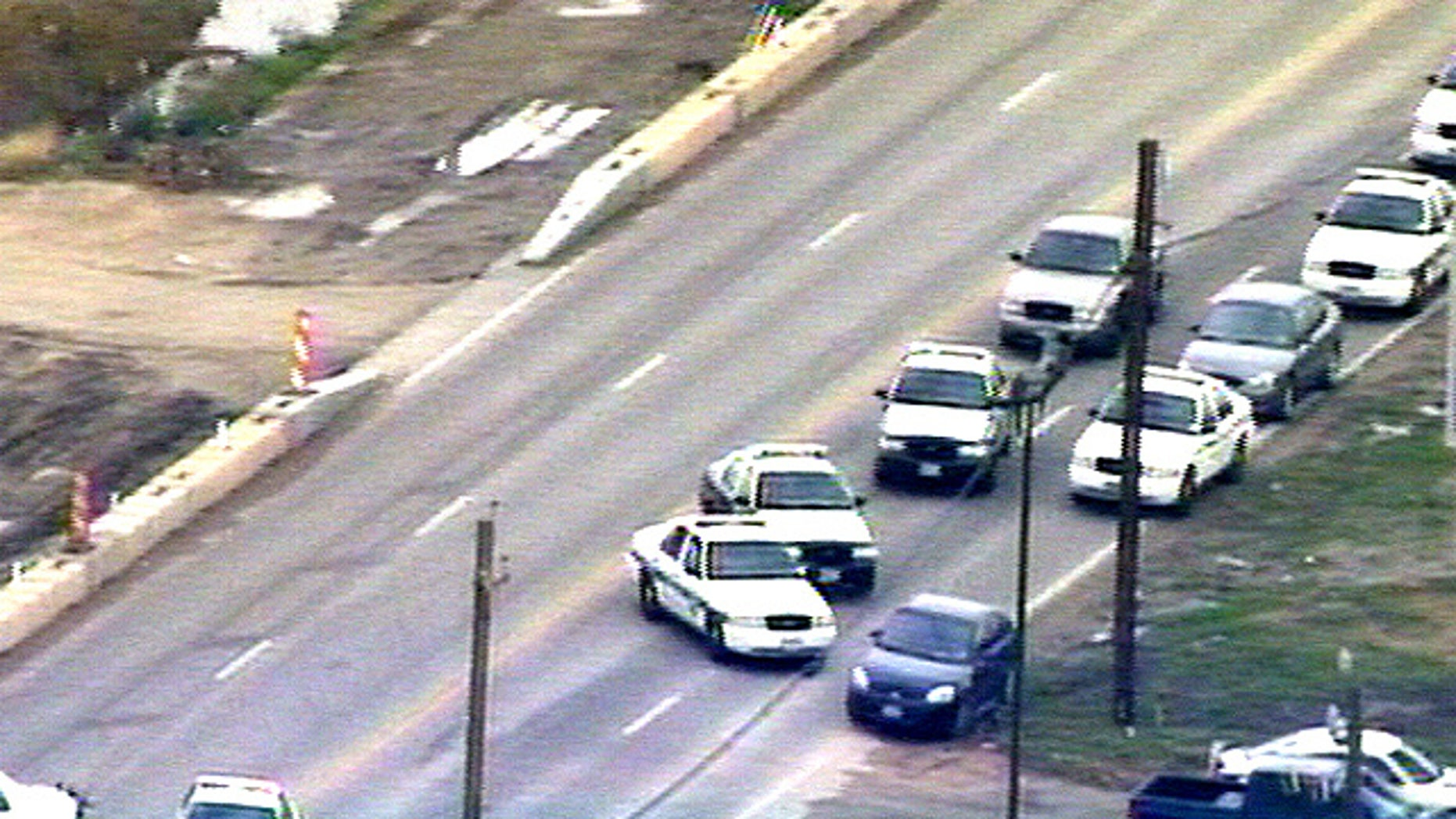 Police block road during Pearland, TX bank robbery.