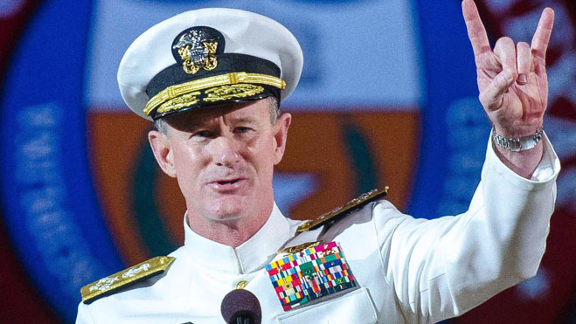 May 17, 2014: Naval Adm. William H. McRaven, an alumnus, does the Longhorns' Hook 'em Horns hand signal during his commencement keynote address at the University of Texas in Austin.