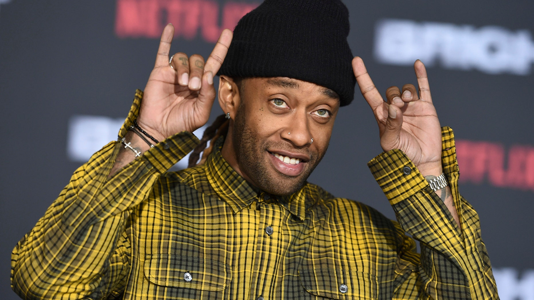 """FILE - In this Dec. 13, 2017, file photo, Ty Dolla $ign arrives at the U.S. premiere of """"Bright"""" at the Regency Village Theatre in Los Angeles. Singer and rapper Ty Dolla $ign has been arrested Wednesday, Sept. 5, 2018, on drug charges in Atlanta. (Photo by Jordan Strauss/Invision/AP, File)"""