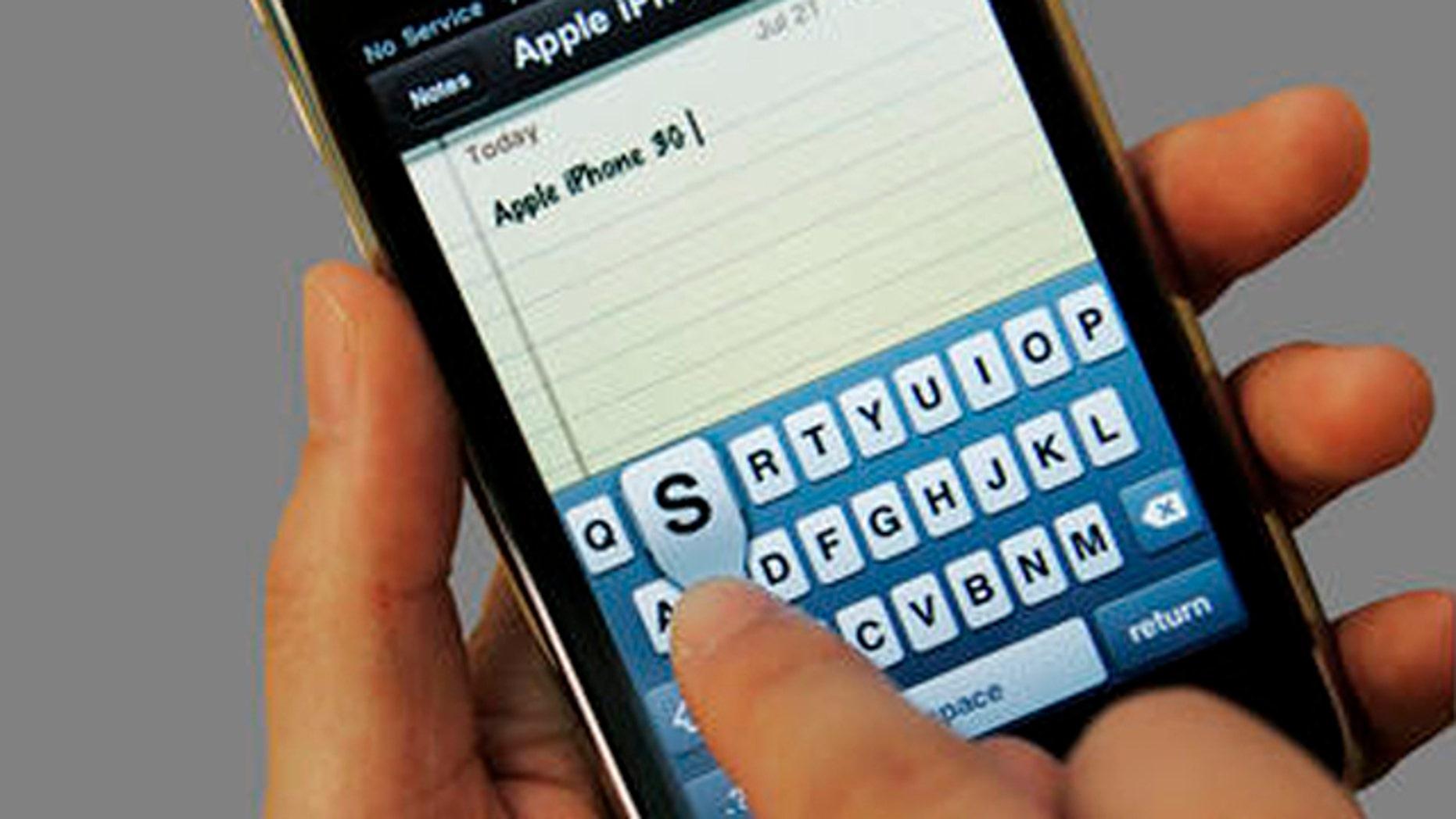 A customer uses an Apple iPhone 3GS at an Apple store in Palo Alto, Calif., Tuesday, July 21, 2009. (AP Photo/Paul Sakuma)