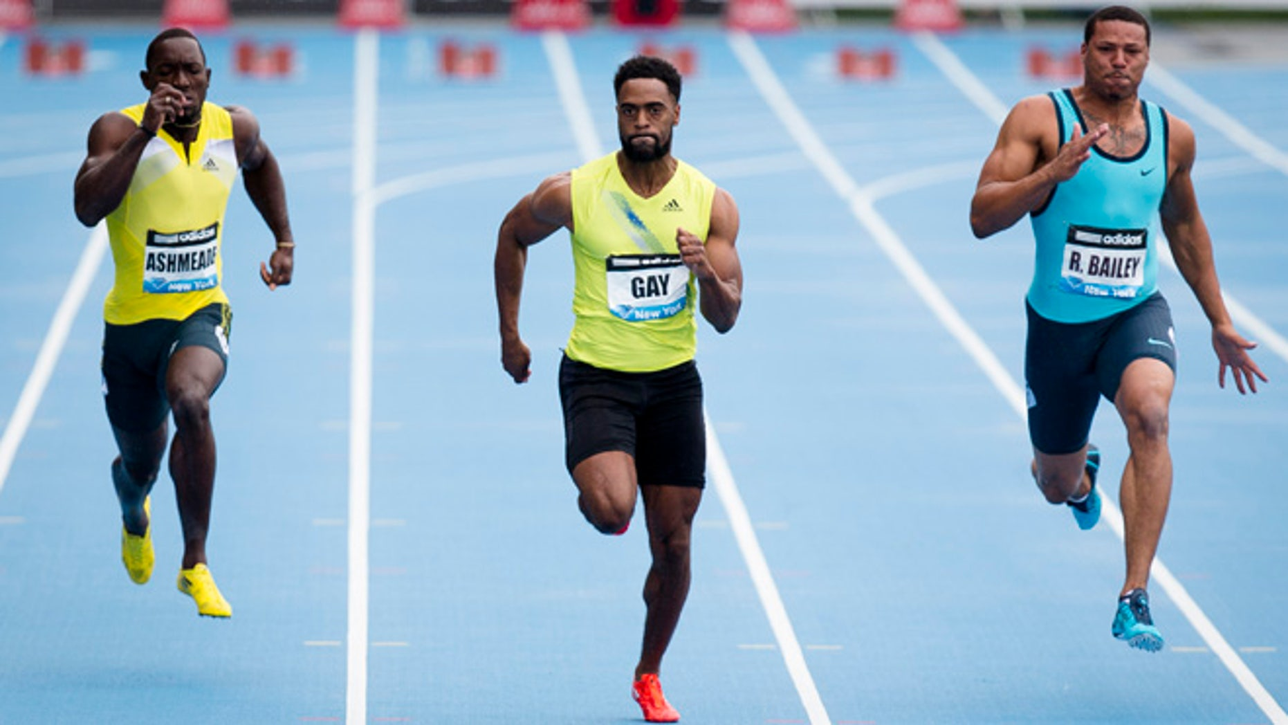 In a May 25, 2013, file photo Tyson Gay, center, competes in the Men's 100m alongside Ryan Bailey,  right, and Nickel Ashmeade, of Jamaica,   during the IAAF Diamond League Grand Prix competition  in New York. Gay was informed Friday July 12, 2013, he has tested positive for a banned substance and says he will pull out of the world championships next month in Moscow.