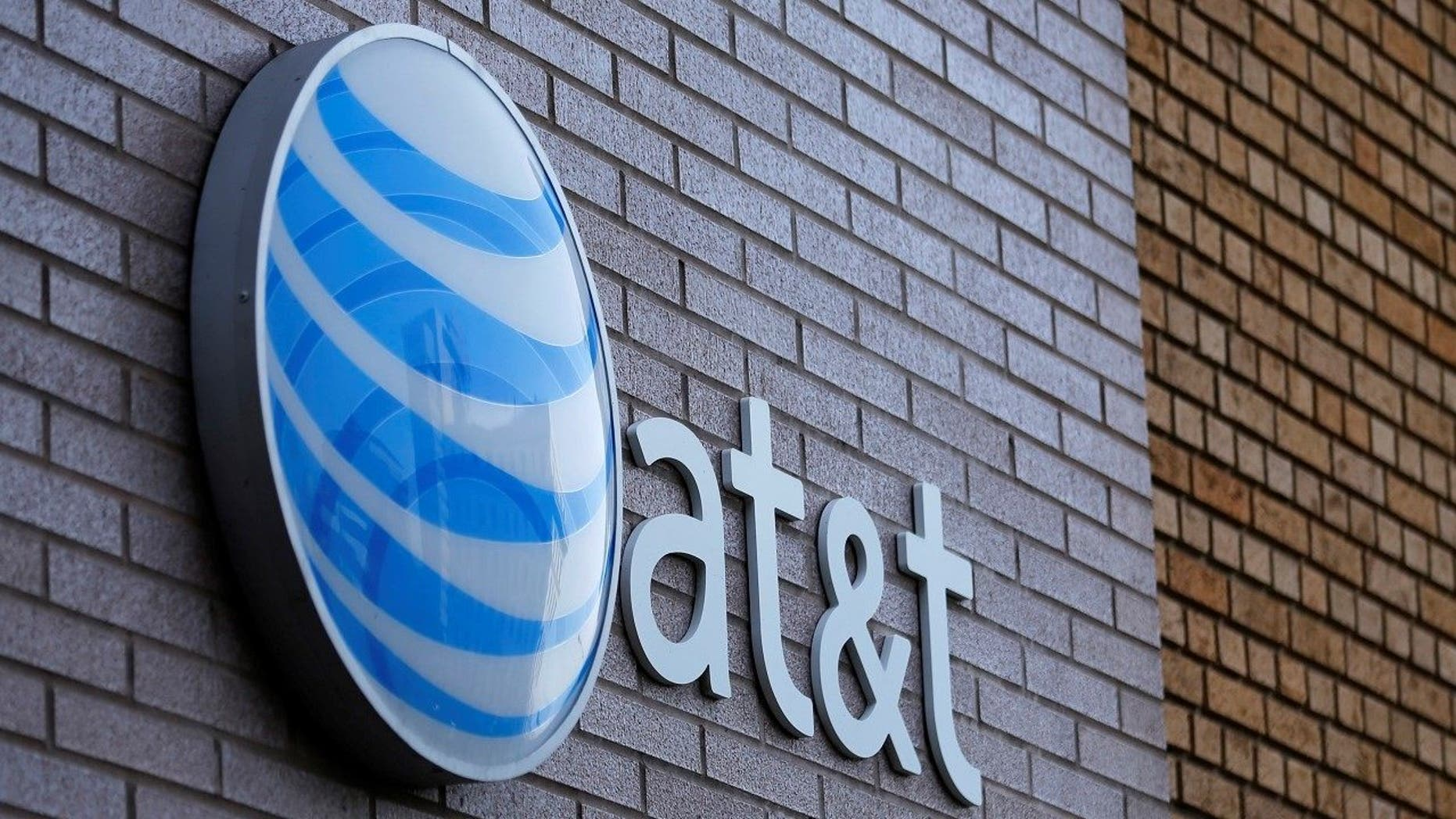 File photo: An AT&T sign is shown on a building in downtown San Diego, California March 18, 2014. REUTERS/Mike Blake