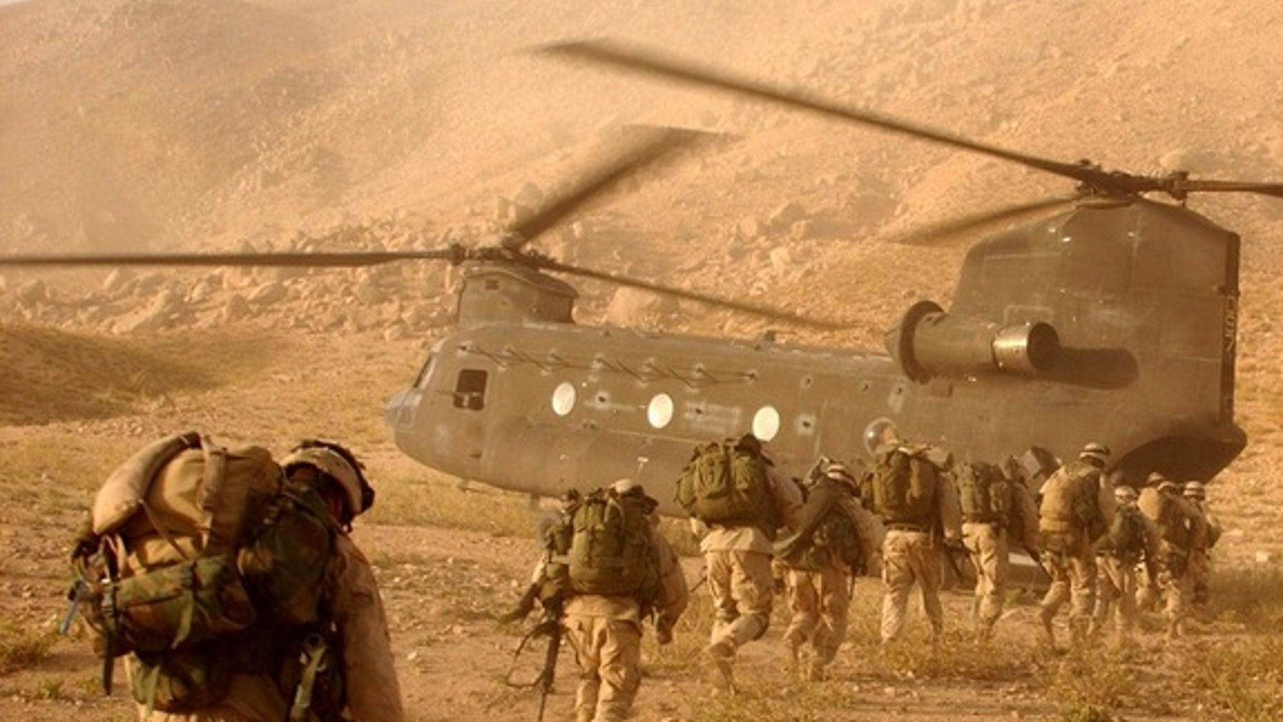 Soliders approach the Chinook helicopter. The researchers' new model could help predict how plasma bubbles could affect future military operations.