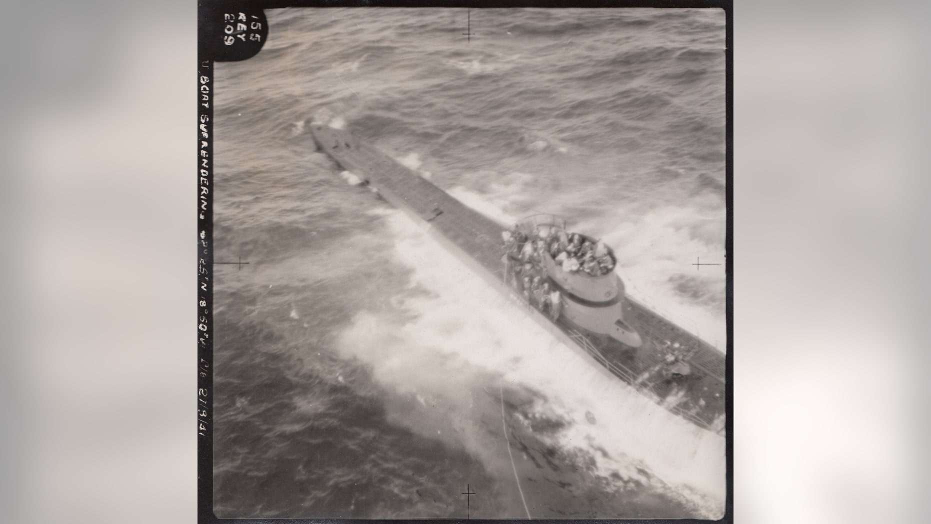 An aerial picture showing the dramatic capture of German submarine U-571 during World War II (Henry Aldridge & Son)