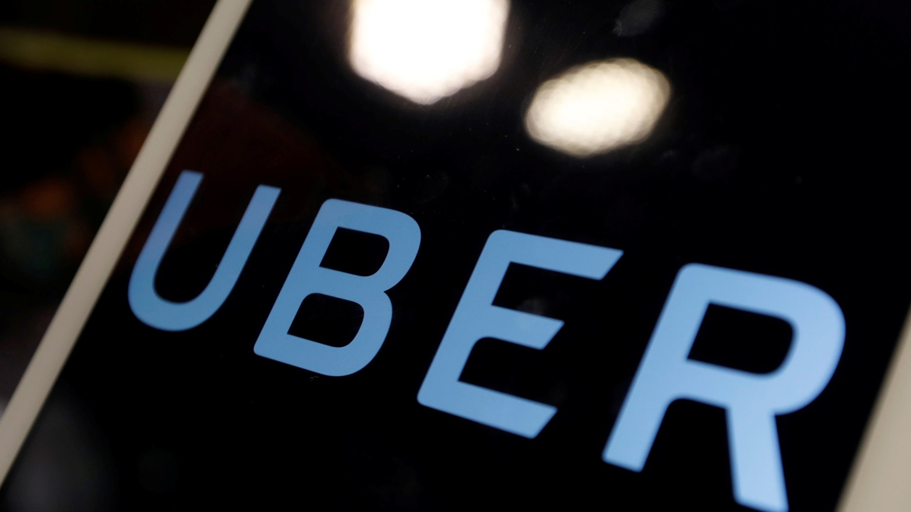 File photo: The logo of Uber is seen on an iPad, during a news conference to announce Uber resumes ride-hailing service, in Taipei, Taiwan April 13, 2017. (REUTERS/Tyrone Siu)
