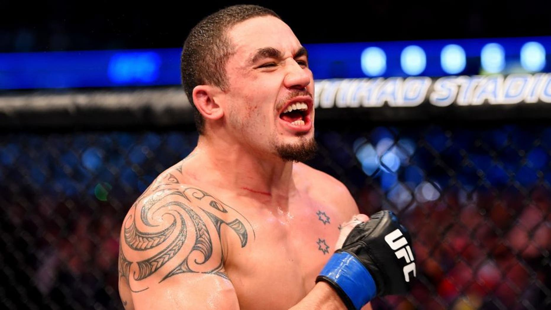 MELBOURNE, AUSTRALIA - NOVEMBER 15: Robert Whittaker celebrates his win by Unanimous Decision against Uriah Hall (not pictured) in their middleweight bout during the UFC 193 event at Etihad Stadium on November 15, 2015 in Melbourne, Australia. (Photo by Josh Hedges/Zuffa LLC/Zuffa LLC via Getty Images)