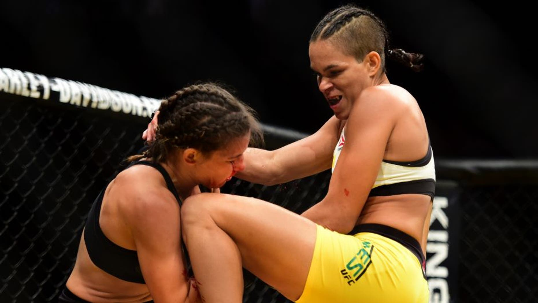 LAS VEGAS, NV - JULY 09: (R-L) Amanda Nunes of Brazil knees Miesha Tate in their UFC women's bantamweight championship bout during the UFC 200 event on July 9, 2016 at T-Mobile Arena in Las Vegas, Nevada. (Photo by Harry How/Zuffa LLC/Zuffa LLC via Getty Images)
