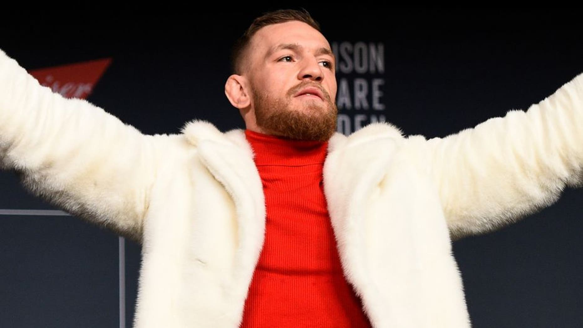 NEW YORK, NY - NOVEMBER 10: UFC featherweight champion Conor McGregor of Ireland interacts with fans and media during the UFC 205 press conference inside The Theater at Madison Square Garden on November 10, 2016 in New York City. (Photo by Jeff Bottari/Zuffa LLC/Zuffa LLC via Getty Images)