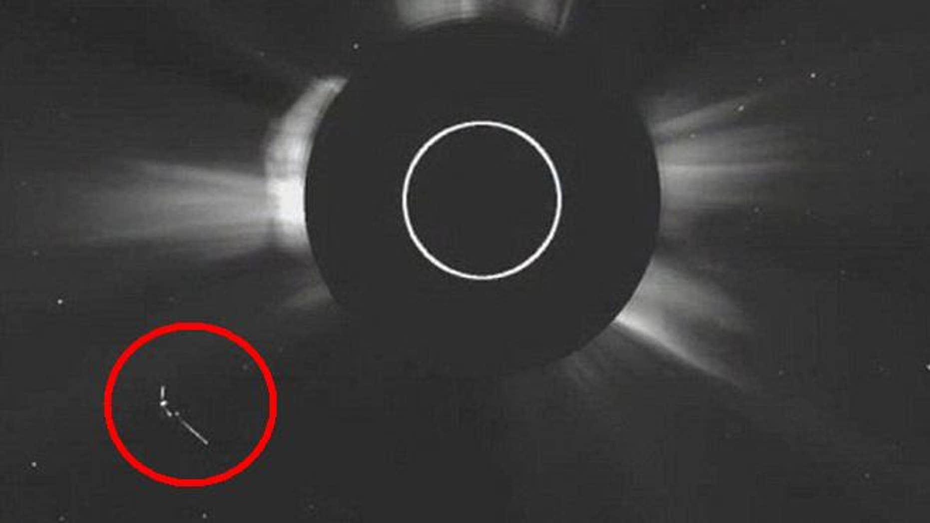 A strangely shaped object near the sun in a new NASA image has drawn the attention of UFO believers.
