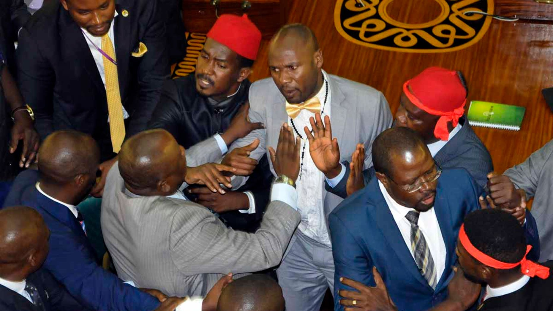 Ugandan lawmakers brawl in the Parliament in Kampala, Uganda, Tuesday, Sept. 26, 2017.