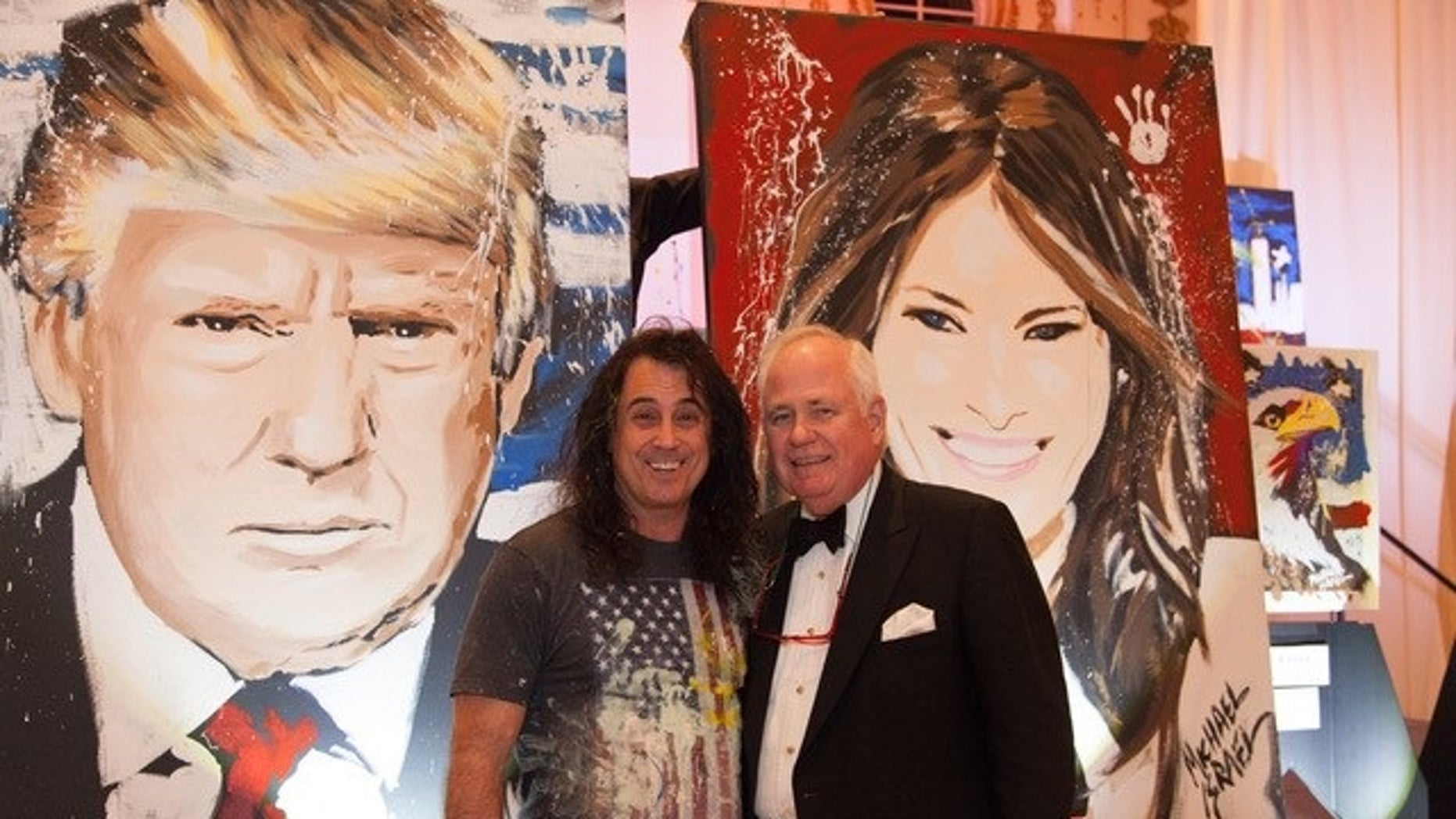 Artist Michael Israel poses with Timothy Lane, the man who bidded the highest for the paintings of President Trump and first lady Melania Trump.