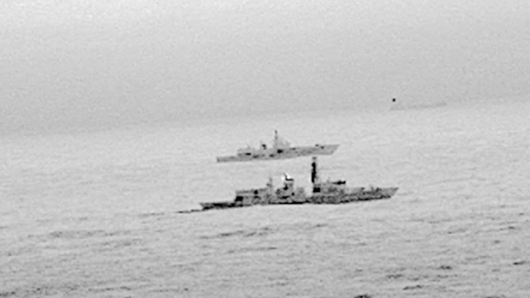 The Royal Navy's HMS St Albans escorts a Russian warship through the North Sea and areas of U.K. interest on Christmas Day, Monday, Dec. 25, 2017.