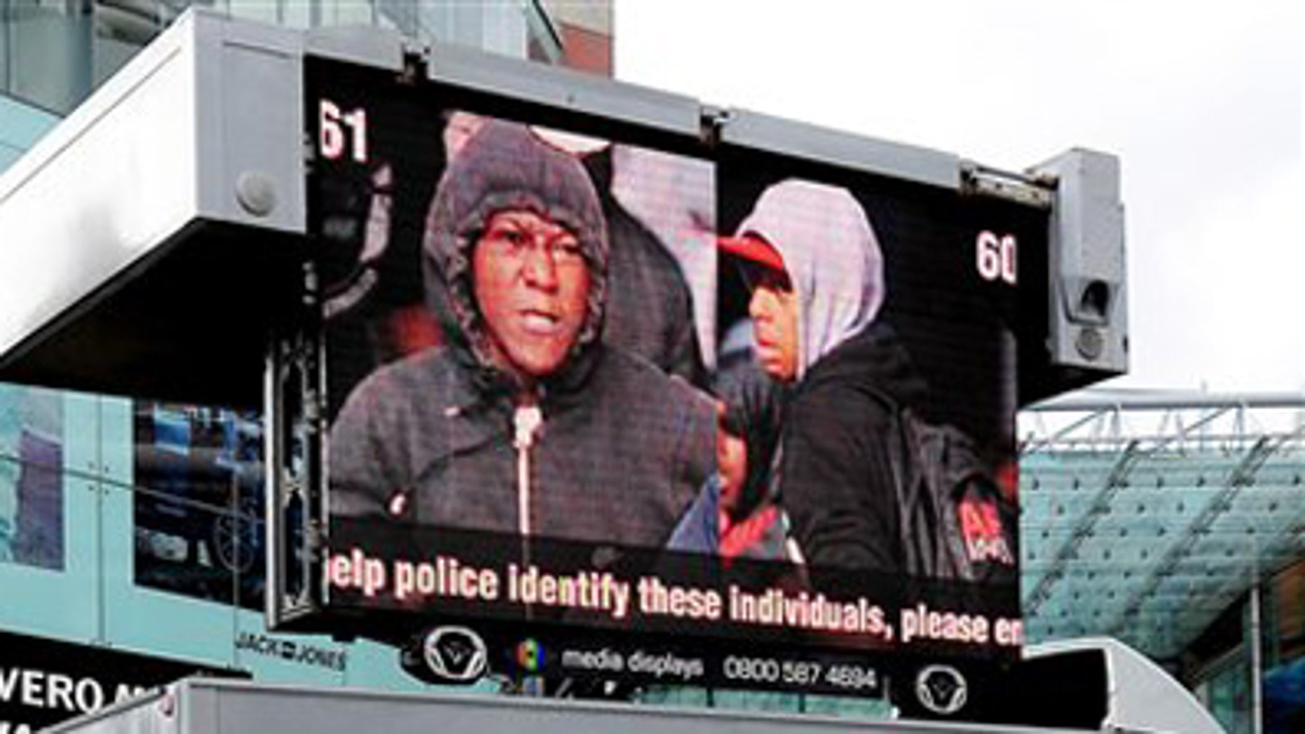 West Midlands Police appeal to the public by displaying pictures of suspected rioters outside the Bull Ring shopping centre in Birmingham England Friday Aug. 12, 2011.