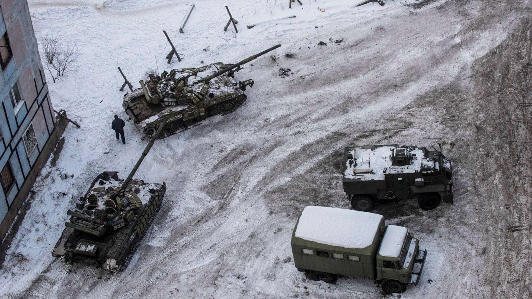 Ukrainian tanks stand in the yard of an apartment block in Avdiivka, eastern Ukraine, Wednesday, Feb. 1, 2017.
