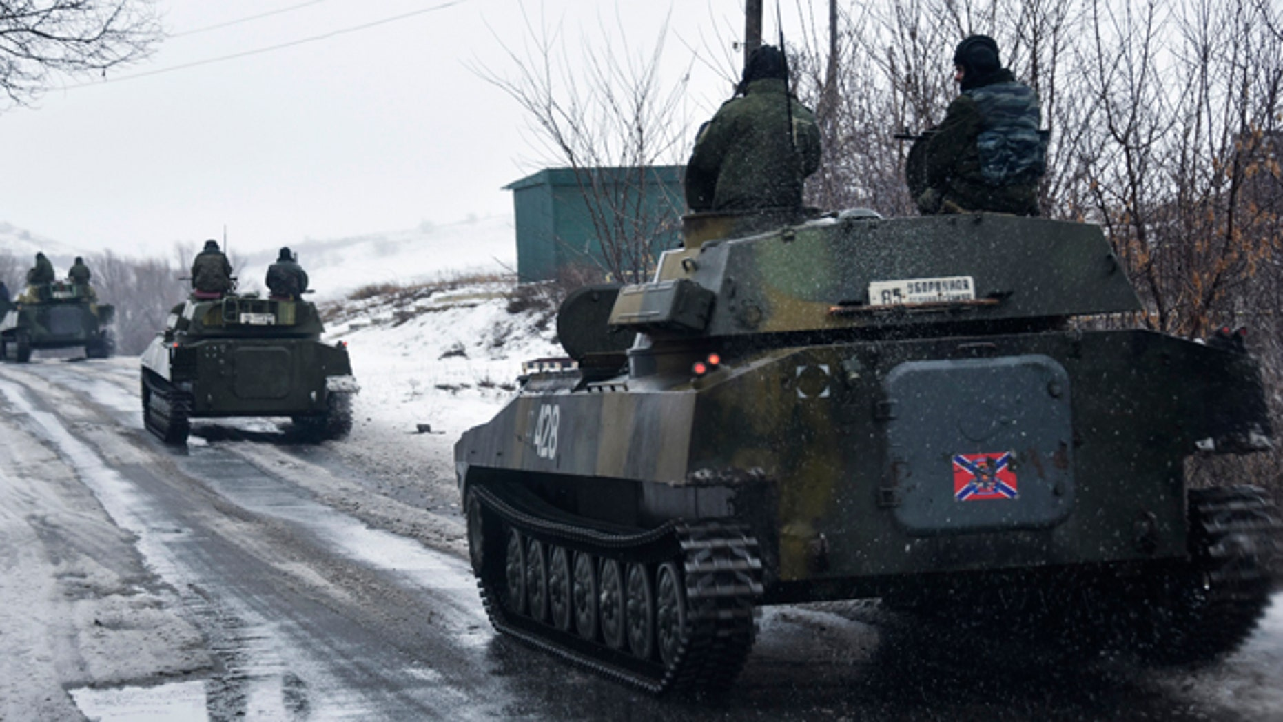 Jan. 21, 2015: A pro-Russian armored vehicle moves toward Slovyanoserbsk, eastern Ukraine. Moscow has proposed restoring a previously agreed line of division in eastern Ukraine to end an escalation of fighting near Donetsk, and has secured rebel agreement to pull back heavy weapons behind it, Russian foreign minister said Wednesday.
