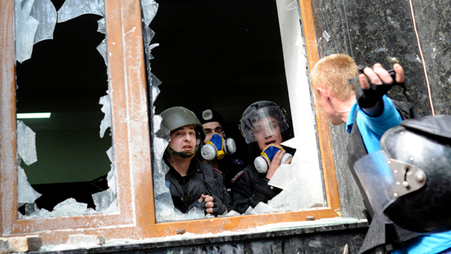 May 1, 2014: A Pro-Russian activist, right, speaks with police officers during clashes in front of the regional administration building in Donetsk, Ukraine. Anti-government demonstrators in Donetsk have stormed the local prosecutor's office. The clash came after a march by several hundred people carrying flags of the Donetsk People's Republic, a movement that seeks either greater autonomy from the central government, or independence and possible annexation by Russia.