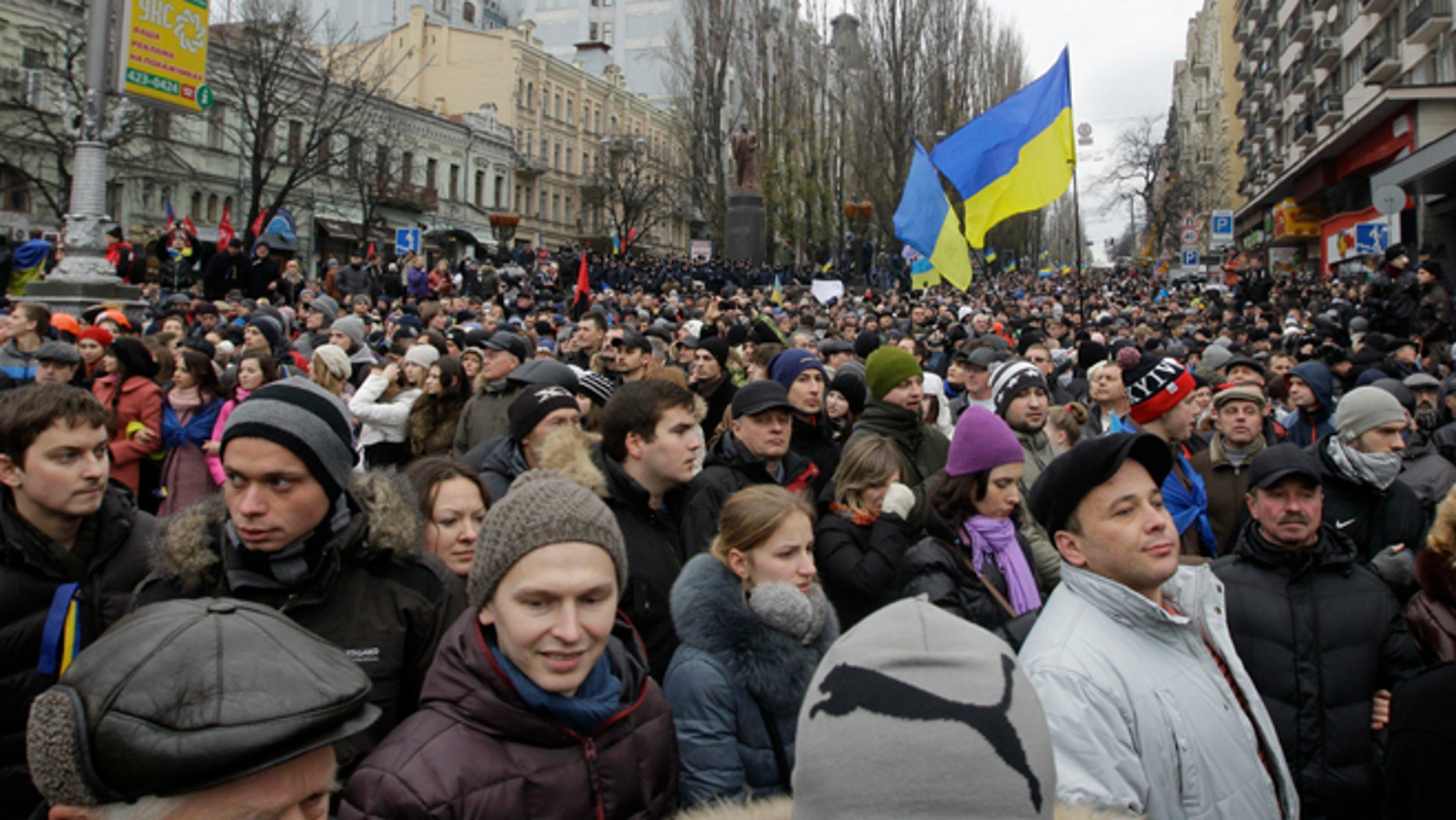 Dec. 1, 2013: Ukrainian protesters crowd a boulevard as they march to Independence square in downtown Kiev, Ukraine.