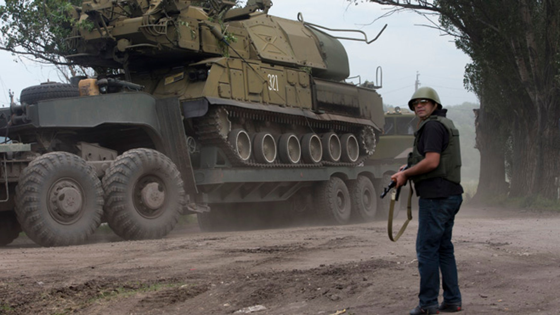 July 4, 2014: Ukrainian government forces maneuver antiaircraft missile launchers Buk as they are transported north-west from Slavyansk, eastern Ukraine.