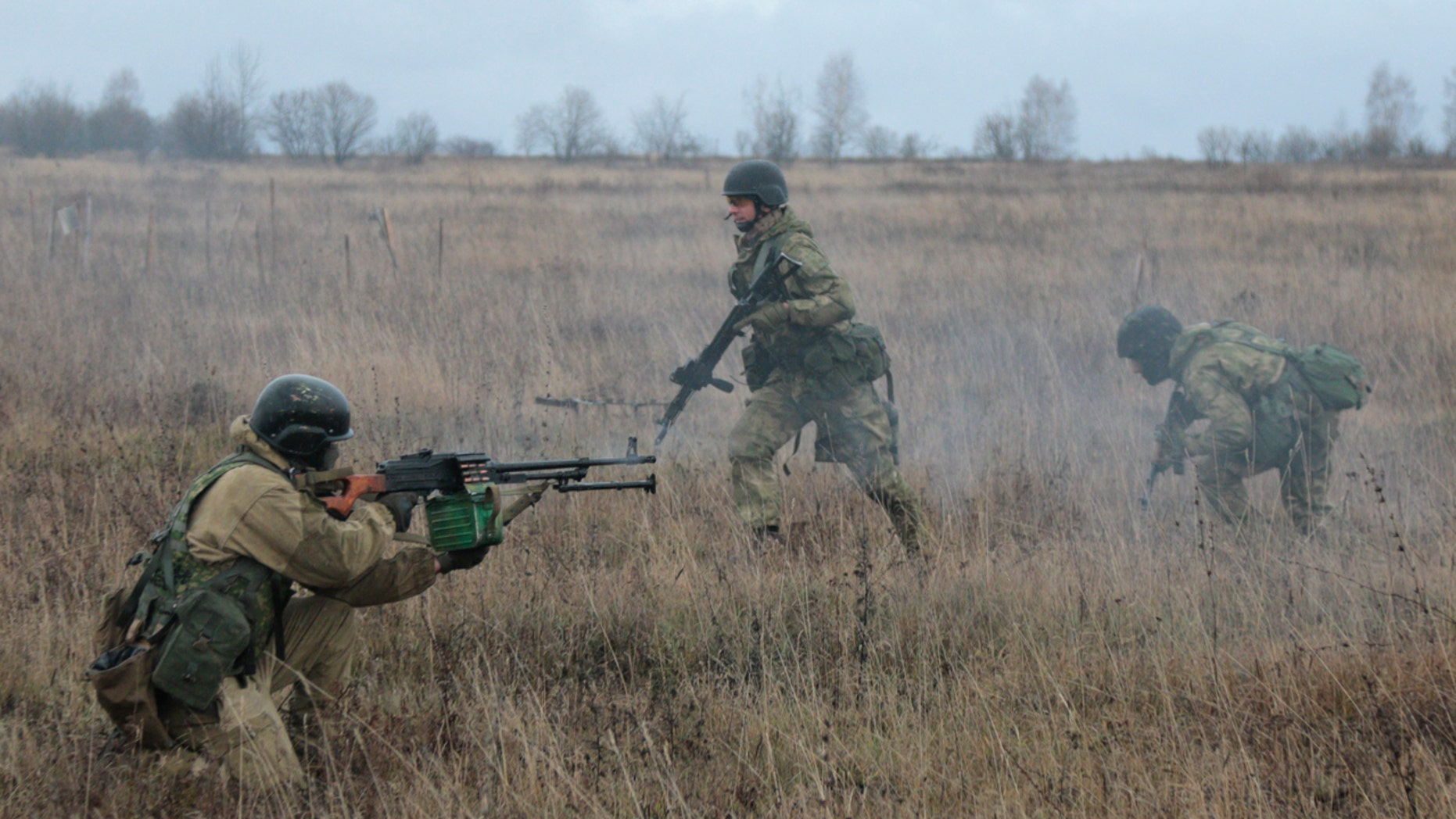 Nov. 21, 2015: US special forces instructors train Ukrainian soldiers at the military training ground in Ukraine's Khmelnitsk region (AP Photo/Aleksandr Shulman)