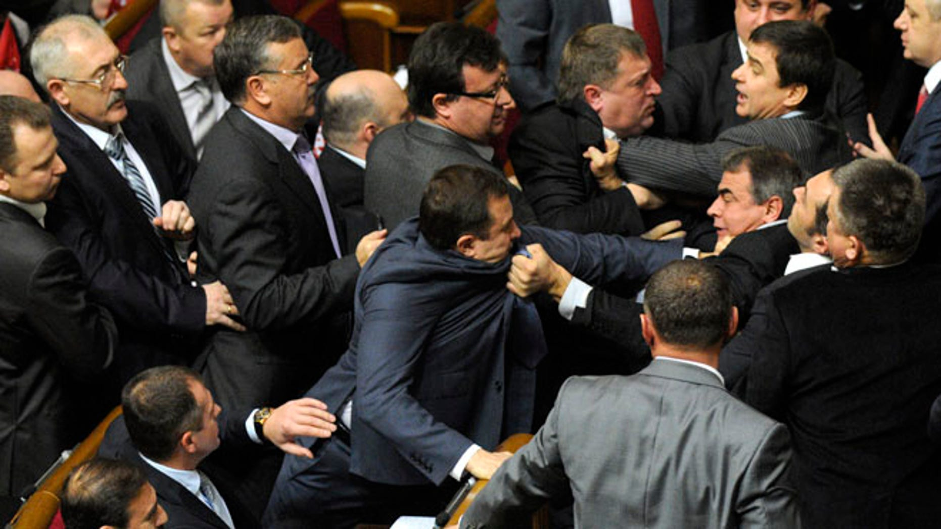 Dec. 13, 2012: Ukrainian lawmakers fight around the rostrum during the first session of Ukraine's newly elected parliament in Kiev, Ukraine.