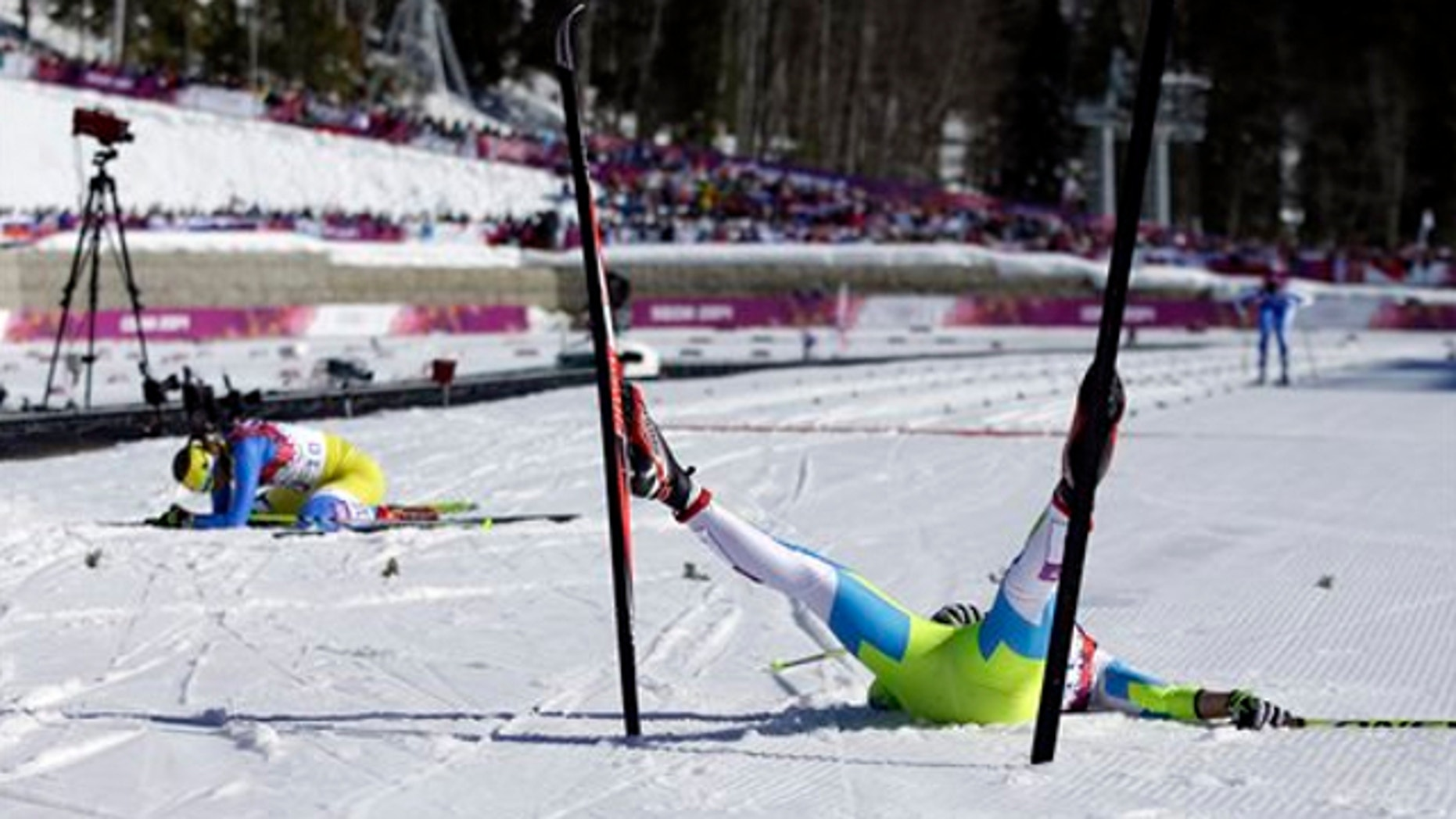 Feb. 13, 2014: Slovenia's Barbara Jezersek, right, and Ukraine's Marina Lisogor lie on the snow after completing the women's 10K classical-style cross-country race at the 2014 Winter Olympics in Krasnaya Polyana, Russia.