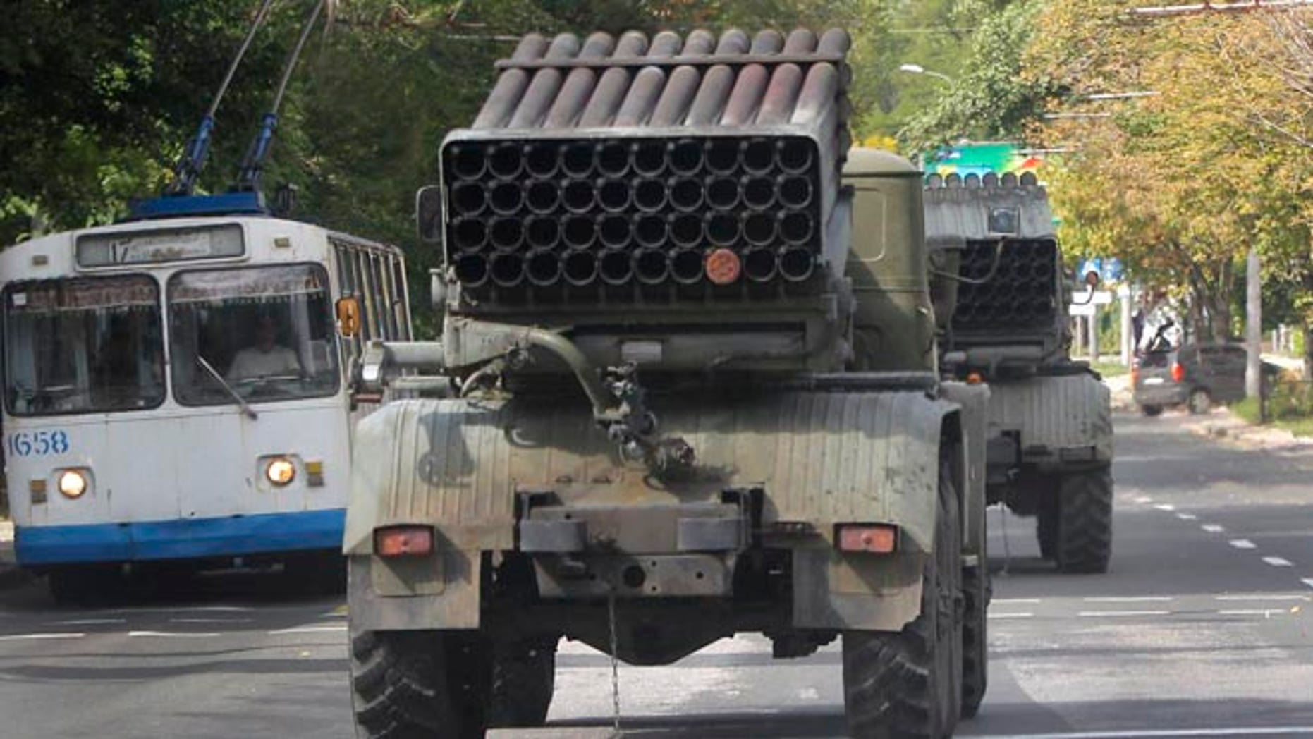 "Sept. 11, 2014: Pro-Russian rebels drive multiple rocket launchers ""Grad"" (means ""hail"") in the town of Donetsk, eastern Ukraine. (AP)"