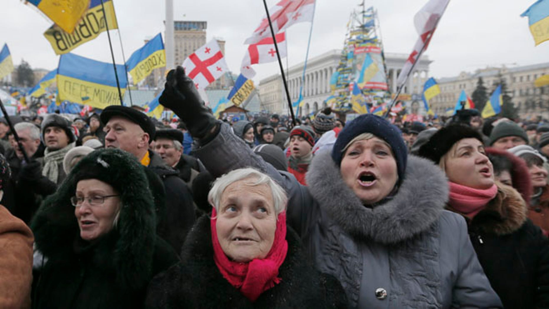 Pro-European Union activists shout slogans during a rally in the Independence Square in Kiev, Ukraine, Saturday, Dec. 7, 2013. As thousands of anti-government protesters kept their vigil in Ukraine's capital Saturday, officials sought to reduce their anger with assurances that Russian and Ukrainian presidents didnt discuss Ukraine joining a Russian-led customs union at a meeting this week. (AP Photo/Efrem Lukatsky)