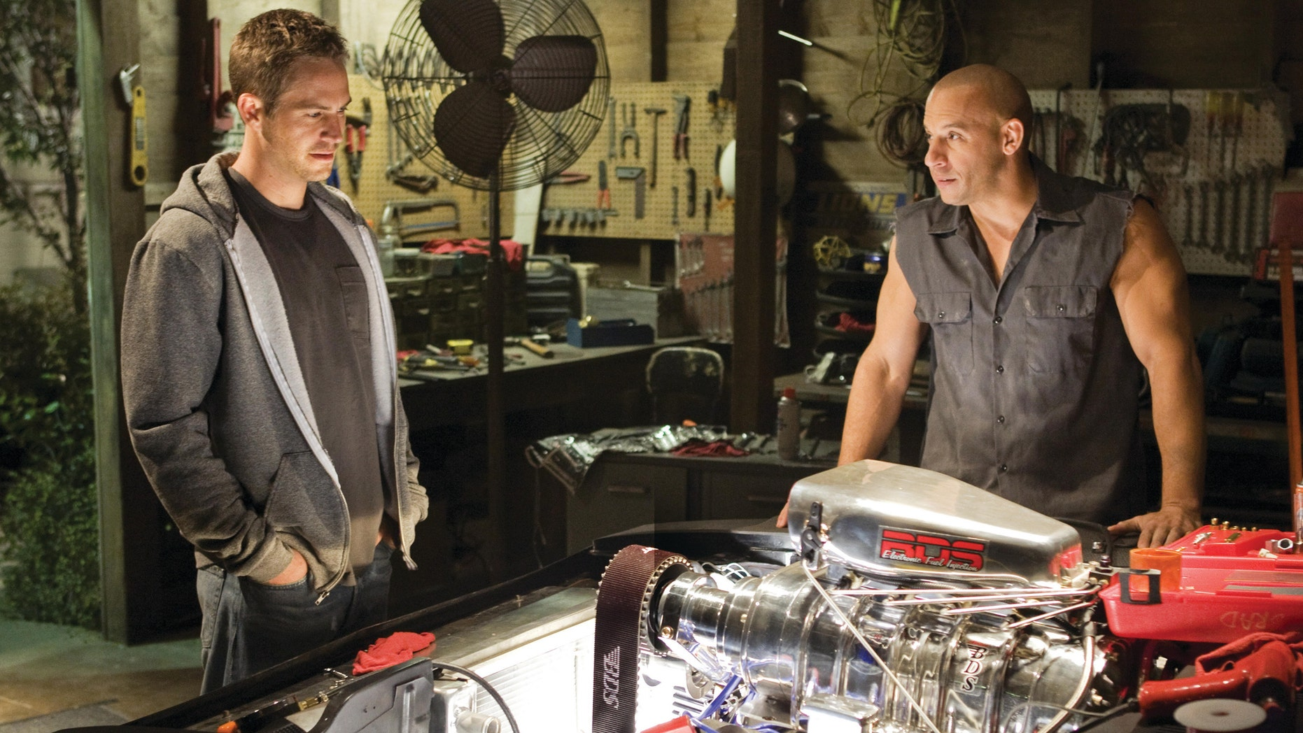 "Paul Walker and Vin Diesel in a scene ""Fast & Furious 7."""